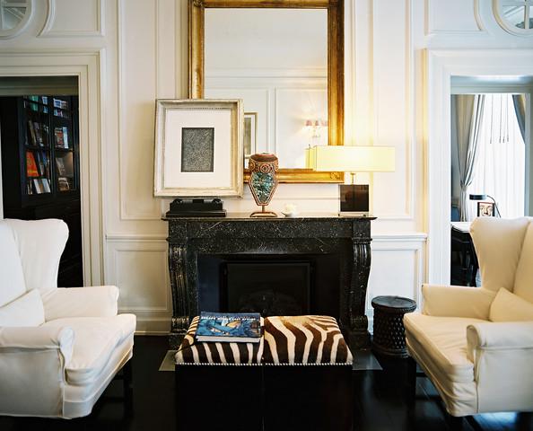 fireplace; living room; mirror; art; outlet on mantel; lamp | Interior Design -er: MIchele Bonan