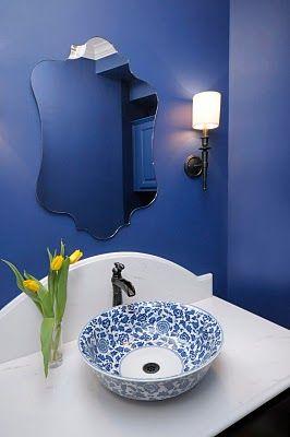 Indigo blue powder bath with arched marble backsplash, Designer: Carla Aston