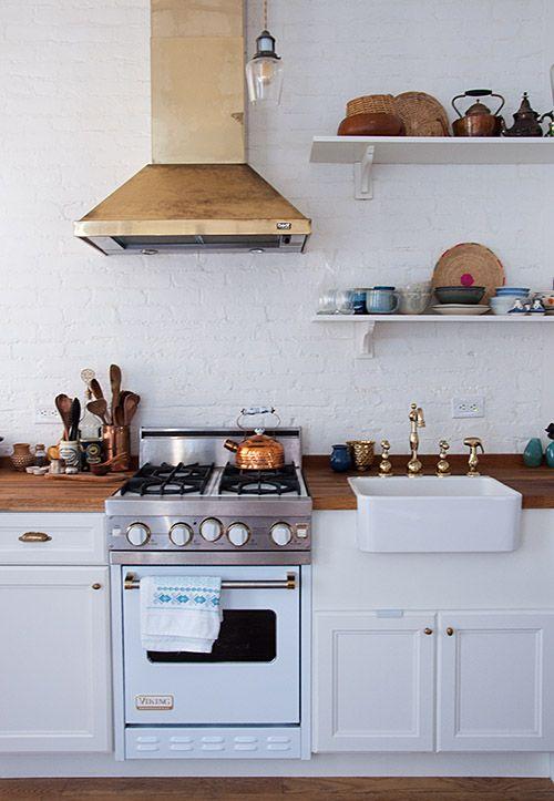 White appliance; brass hood; kitchen | Interior design -er: Farah Malik