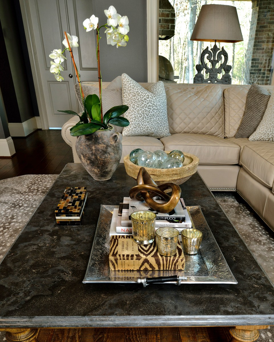 Featured / pictured in article: coffee table, styled; living room; sofa; candle;  flowers; interior design book; tray, knot, box, bowl, glass ball, etc. decor | Styling:interior designer Carla Aston