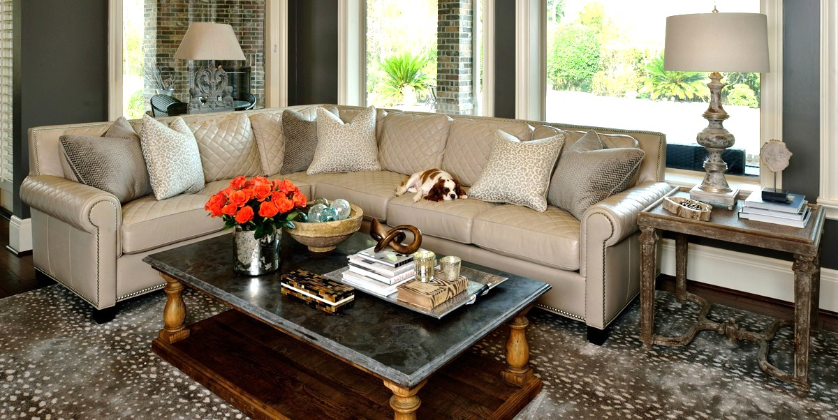 Featured / pictured in article: coffee table, styled; living room; sofa; candle;  flowers; interior design book; tray, knot, box, bowl, glass ball, etc. decor | Styling done by interior designer Carla Aston