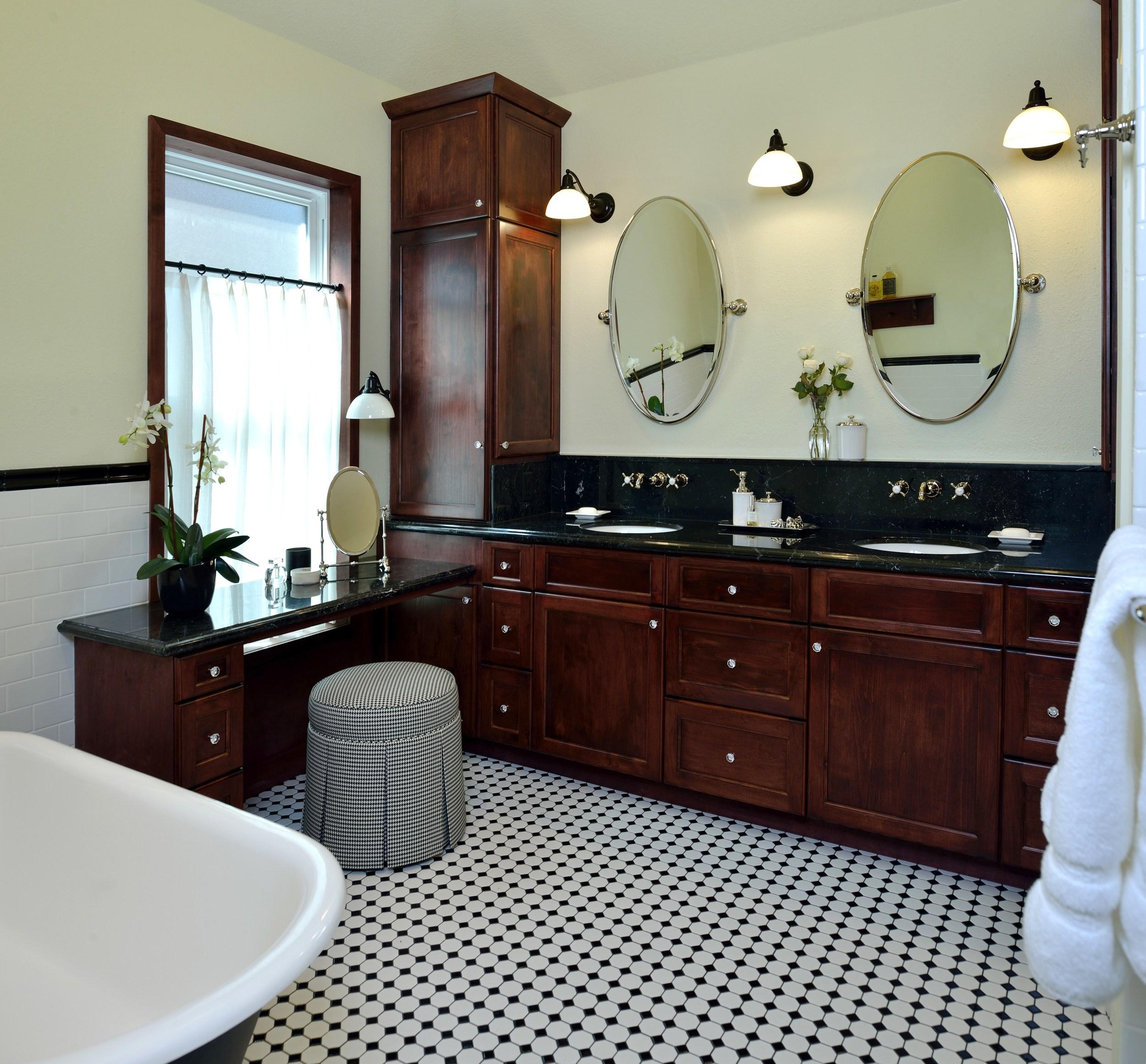 Vintage-inspired master bathroom| Interior Designer: Carla Aston / Photographer: Miro Dvorscak / black and white tile, black marble, cafe curtain, houndstooth, tilt mirrors, claw foot tub