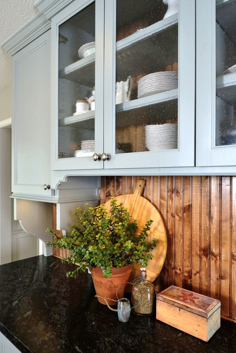 Before & After: A cottage / country style kitchen enjoys wide open space| Interior Designer: Carla Aston / Photographer: Miro Dvorscak — soapstone counters, island; white and gray cabinet; hardwood floor; lighting; hutch