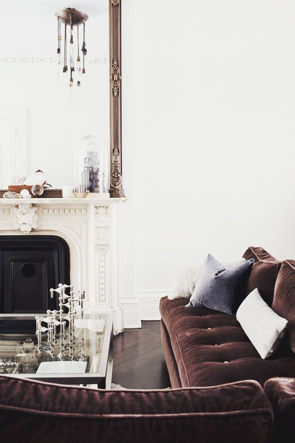 living room couch, fireplace, glass table, pillow, mirror| Designer:  Michelle James  / Image source:  this is glamorous