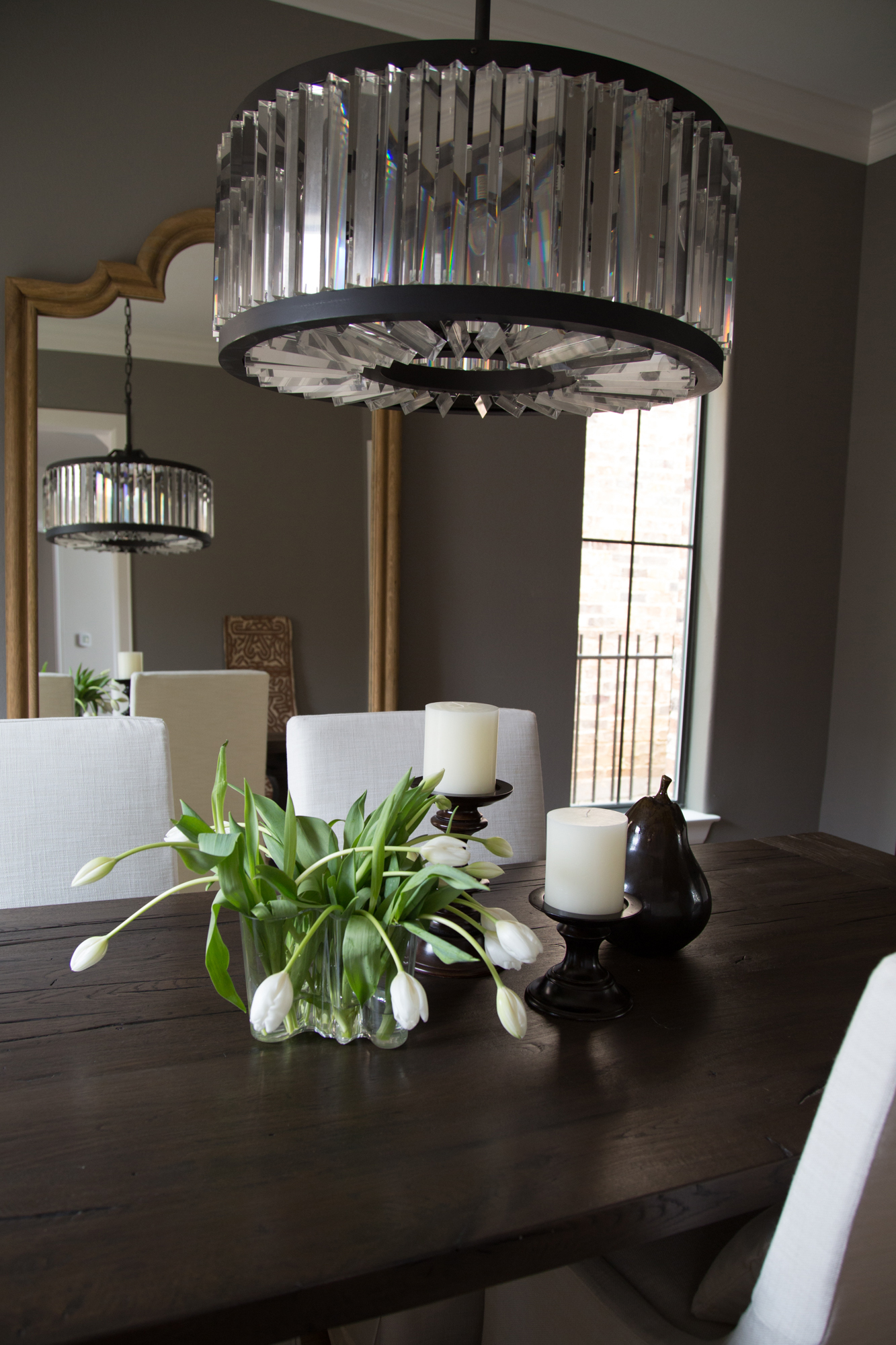 wood dining room table; candle; mirror; lighting; chair | Interior Designer: Carla Aston / Photographer: Tori Aston