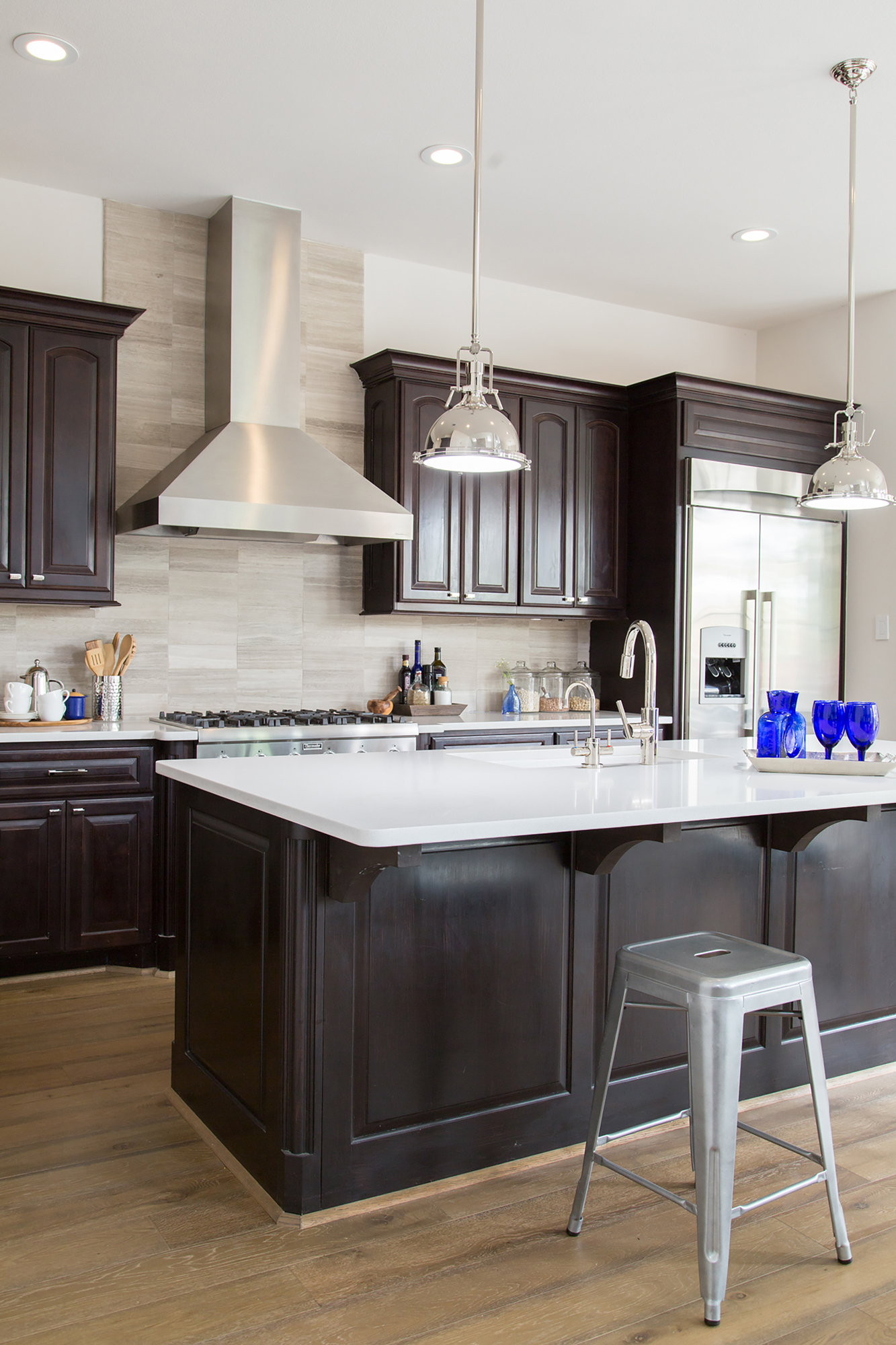 kitchen remodel; Island; stool; cabinetry; sink; lighting | Interior Designer: Carla Aston / Photographer: Tori Aston