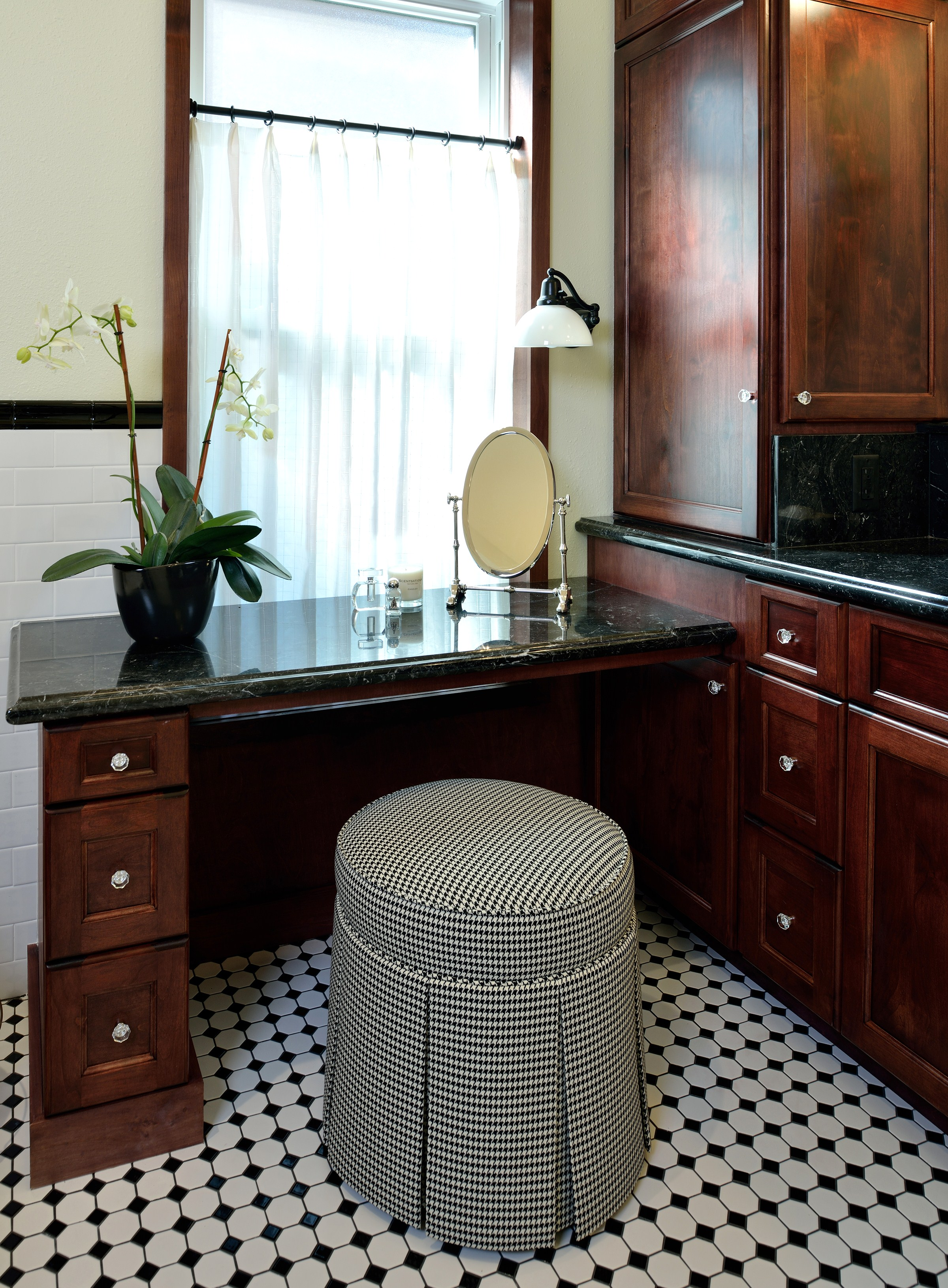 Make up vanity with houndstooth stool and black and white tile floor, Designer: Carla Aston