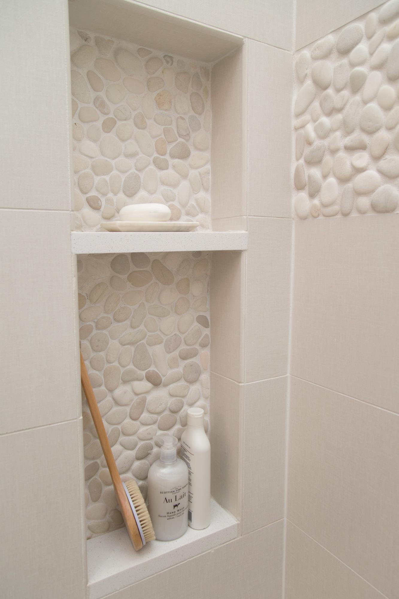 Master bathroom remodel with shower shampoo niche in pebble tile | Interior Designer: Carla Aston / Photographer: Tori Aston #bathroomideas #bathroomremodel #shampooniche #bathroomshower