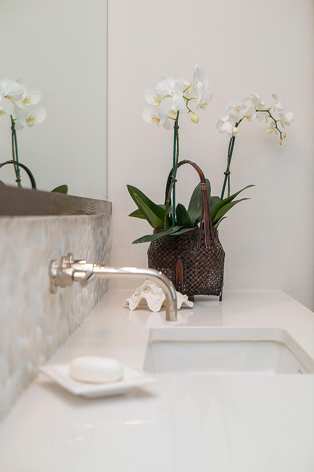Master bathroom remodel with wall mount faucet on pebble tile backsplash | Interior Designer: Carla Aston / Photographer: Tori Aston #bathroomideas #bathroomremodel #wallmountfaucet #pebbletile