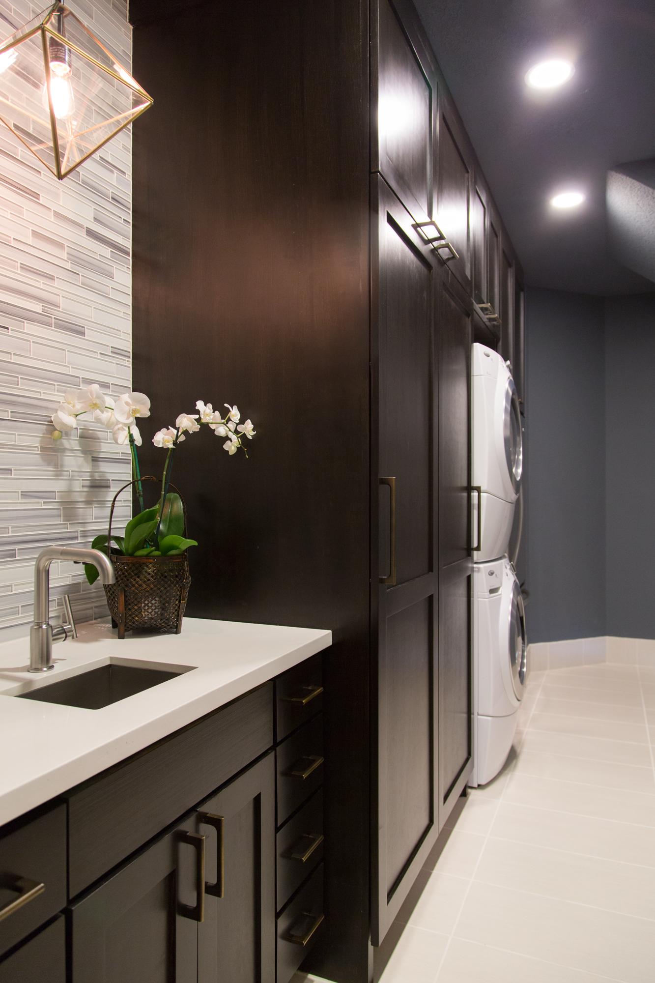 Laundry room remodel; sink; countertop; storage; cabinetry | Interior Designer: Carla Aston / Photographer: Tori Aston