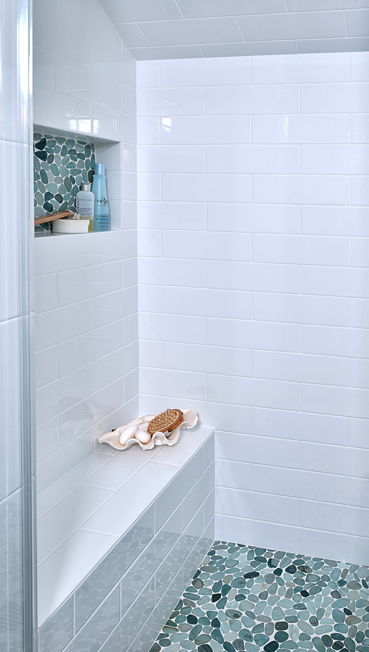 SEE THE FULL REMODEL:    Before & After: This Upstairs Bathroom Gets A Fresh Update    | Photographer: Miro Dvorscak