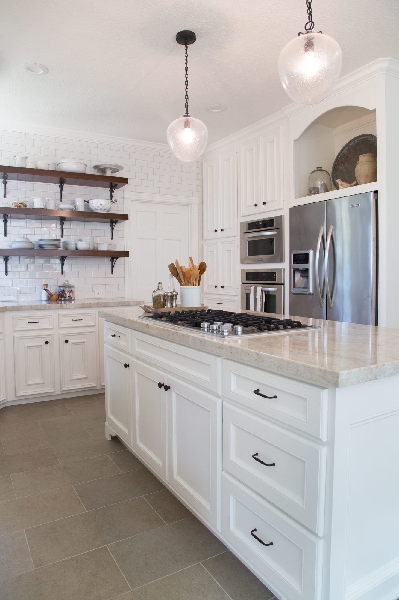 Kitchen Remodel - Open shelving, subway tile wall, new island and frig wall cabinetry, Designer: Carla Aston