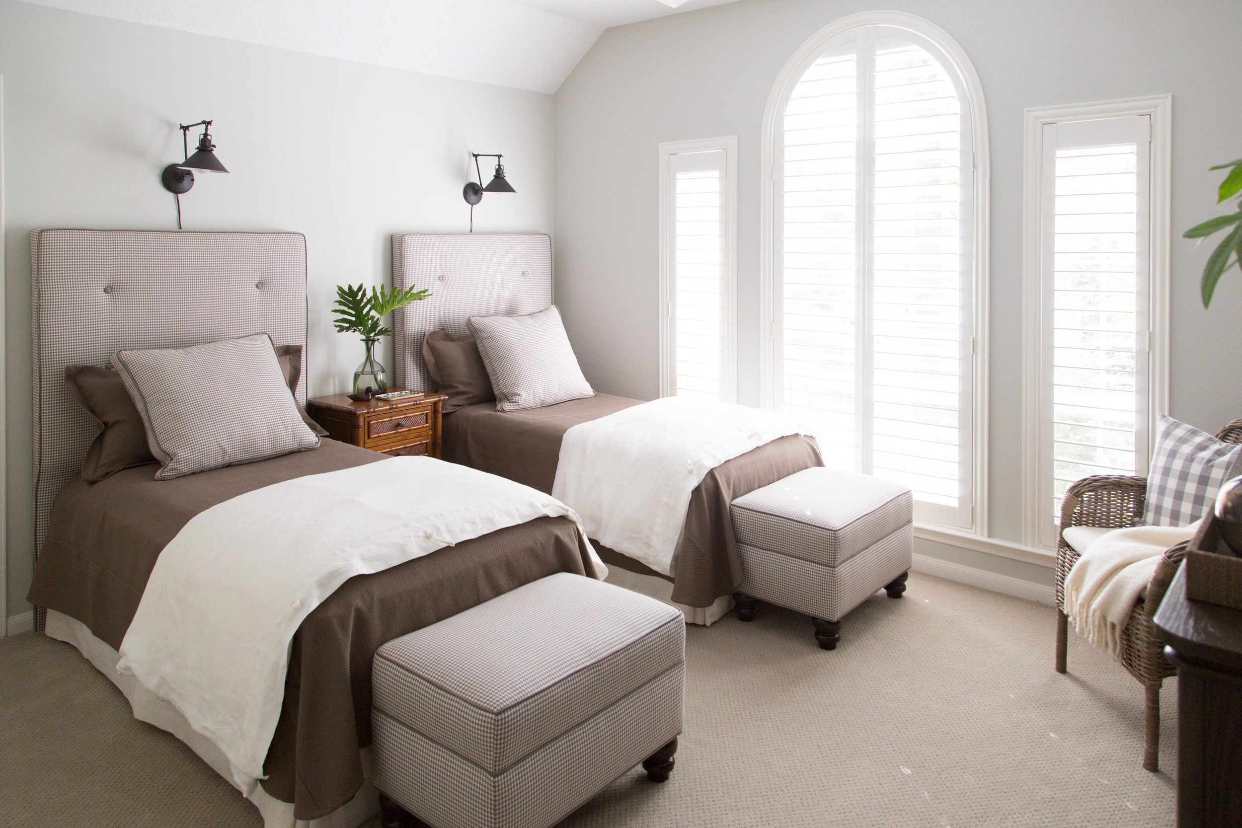 Twin Beds Guestroom with custom headboards, bedding and ottomans, Designer: Carla Aston