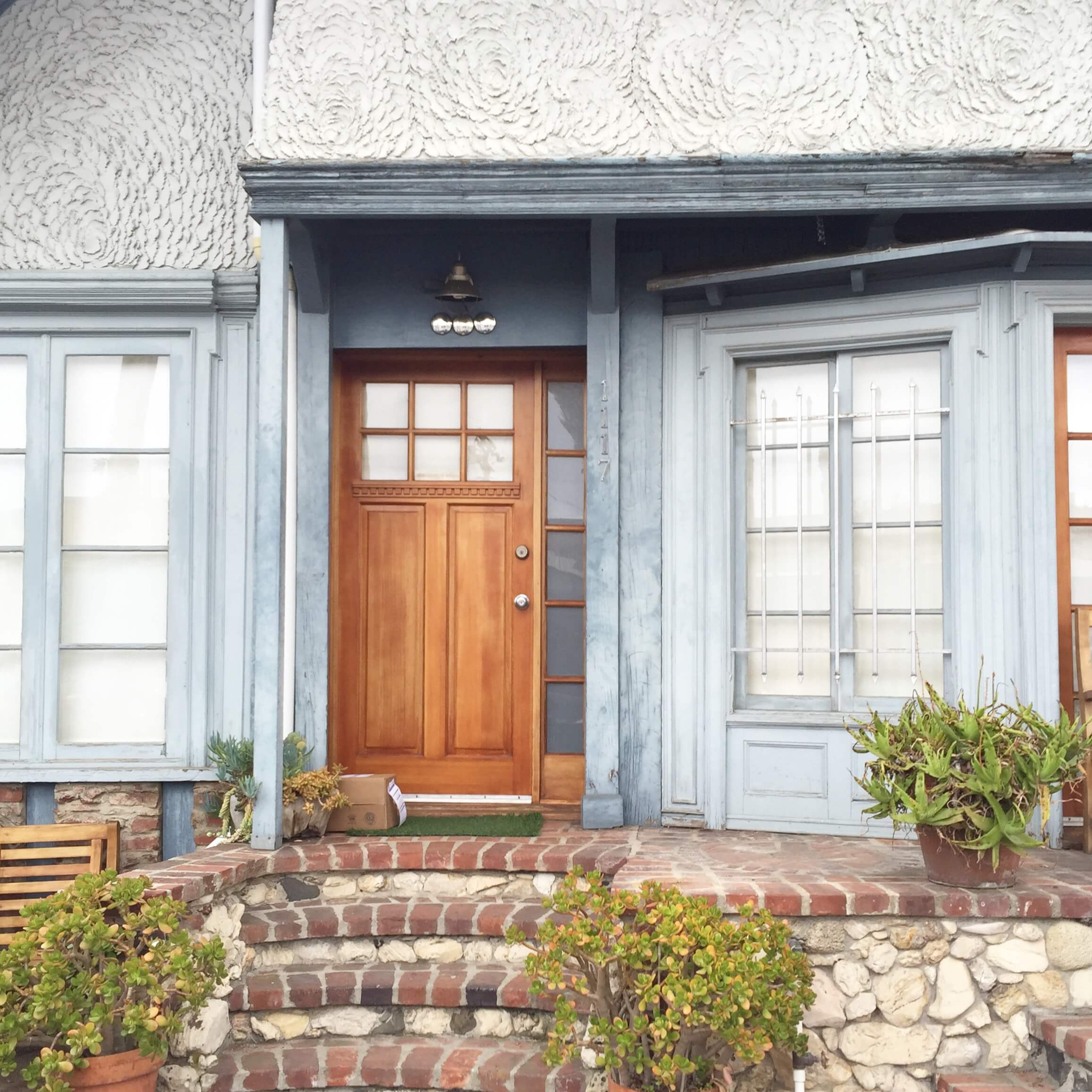 Slate gray and warm wood tone at entry