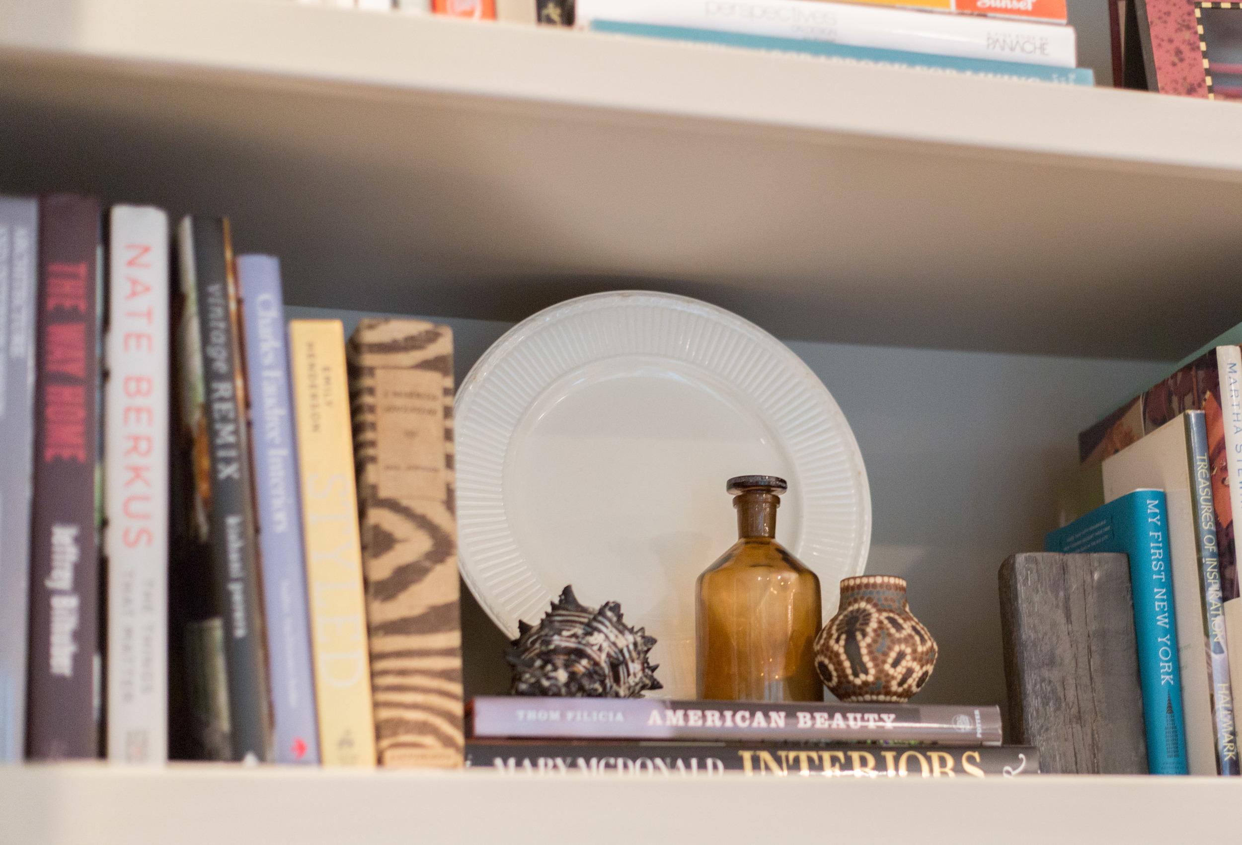 Plate on a bookshelf, Bookshelf Styling   Tori Aston, photographer