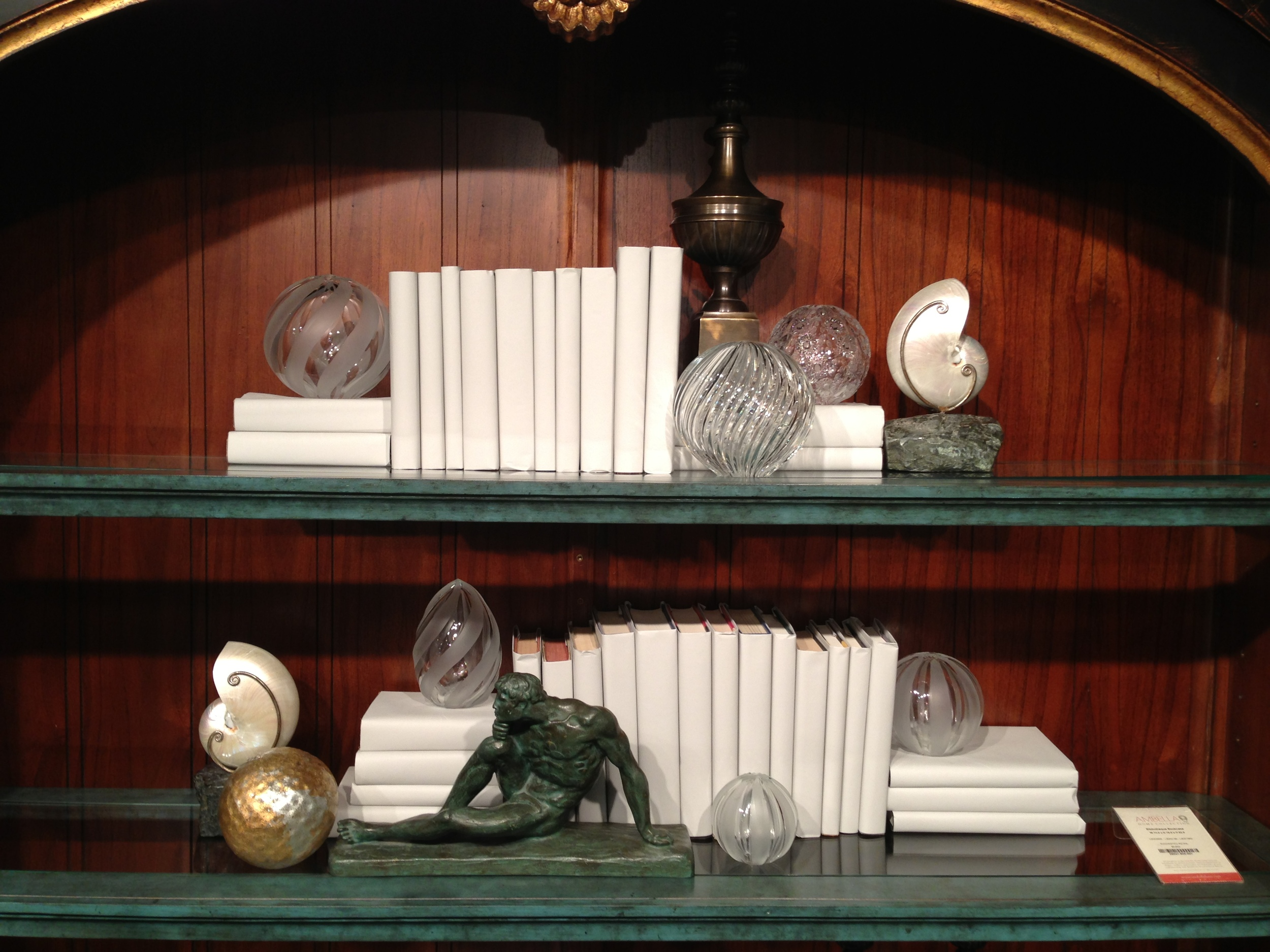 Nice composition of covered books seen at Dallas Market | Bookshelf Styling Tips