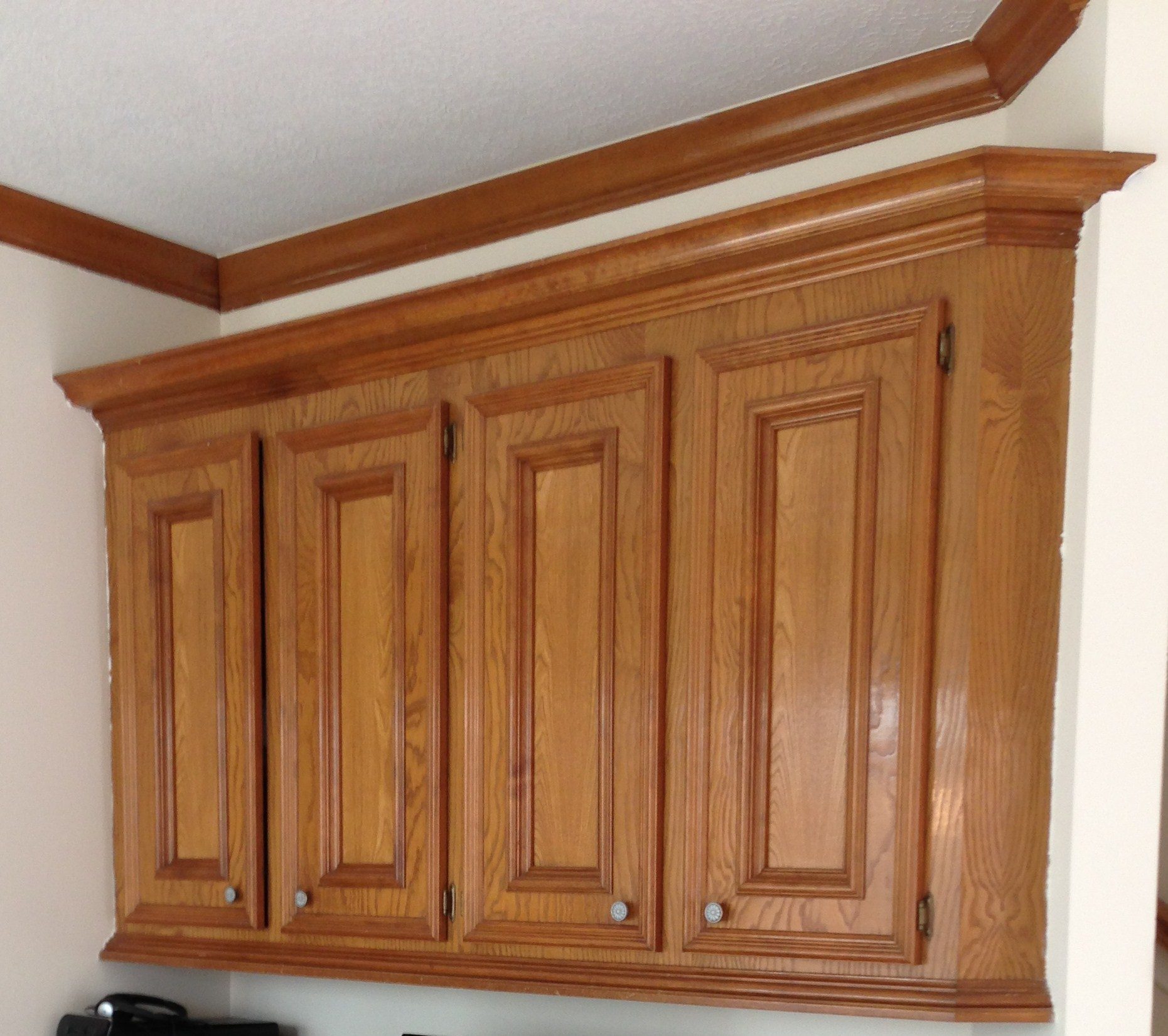 Dated cabinetry with old style hinges.