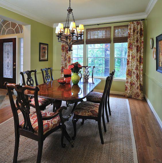 Colorful patterned drapery panels make this dining room fun  Carla Aston, Designer #windowtreatment #wovenwoodshade