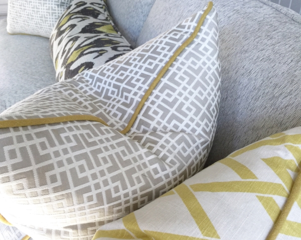 Coordinated custom throw pillows with contrasting welting and down fill | Designer: Carla Aston #pillows #sofapillows