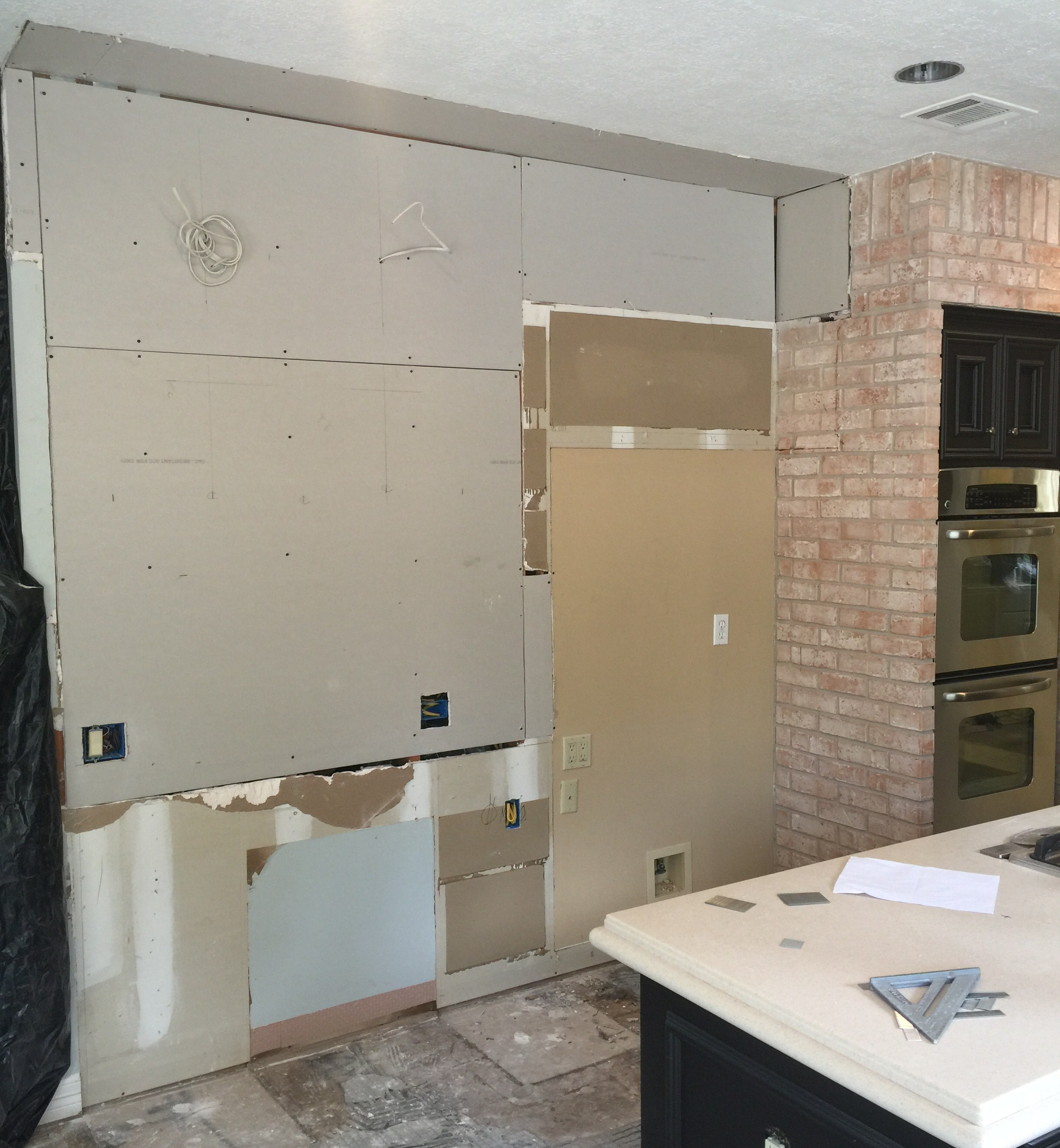 Progress Shot - New full height refrigerator cabinet to go in with new lower cabs and open shelving above