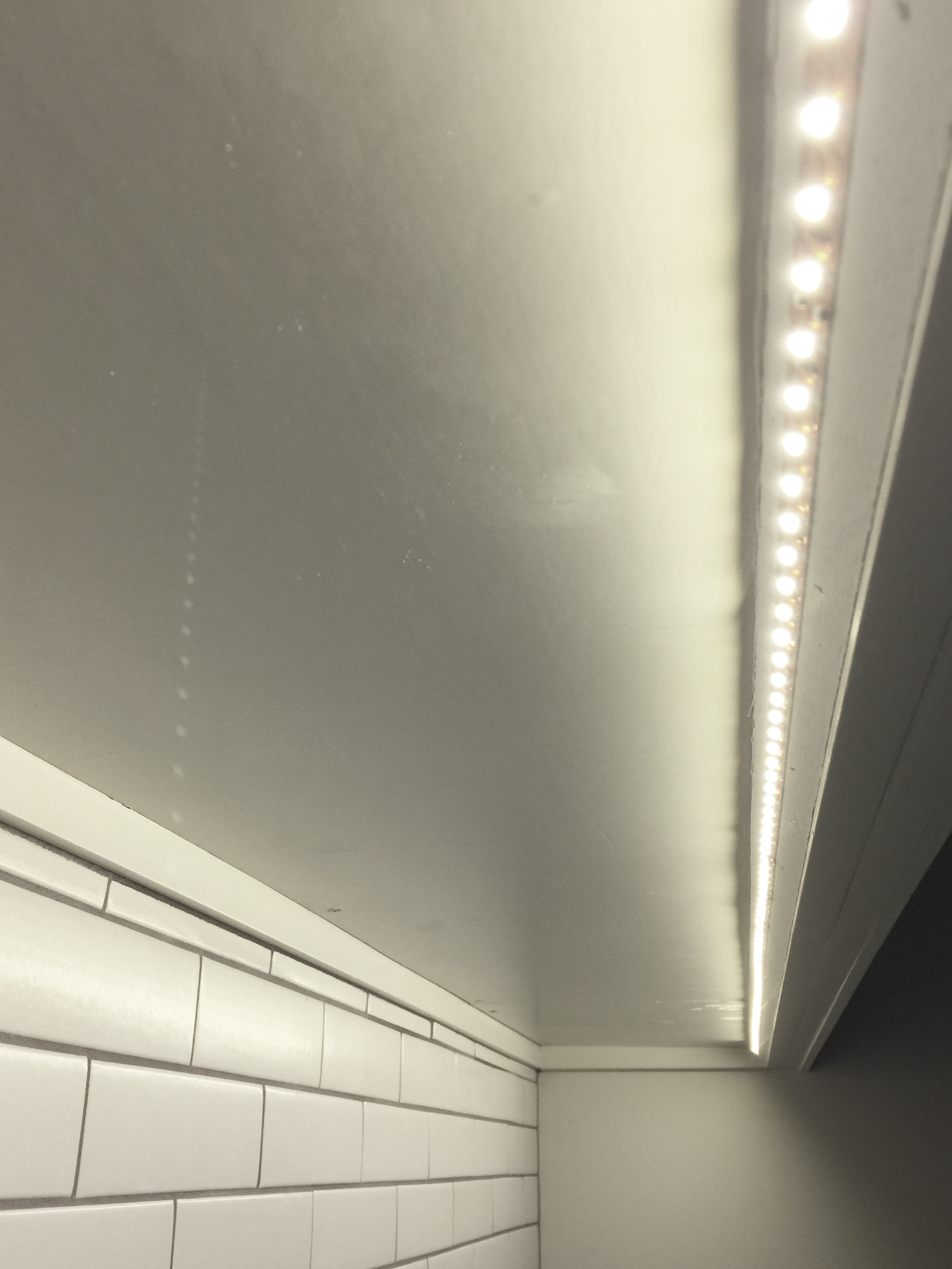 LED undercabinet lighting used in my kitchen remodel, angled so as not to reflect into the countertop below.