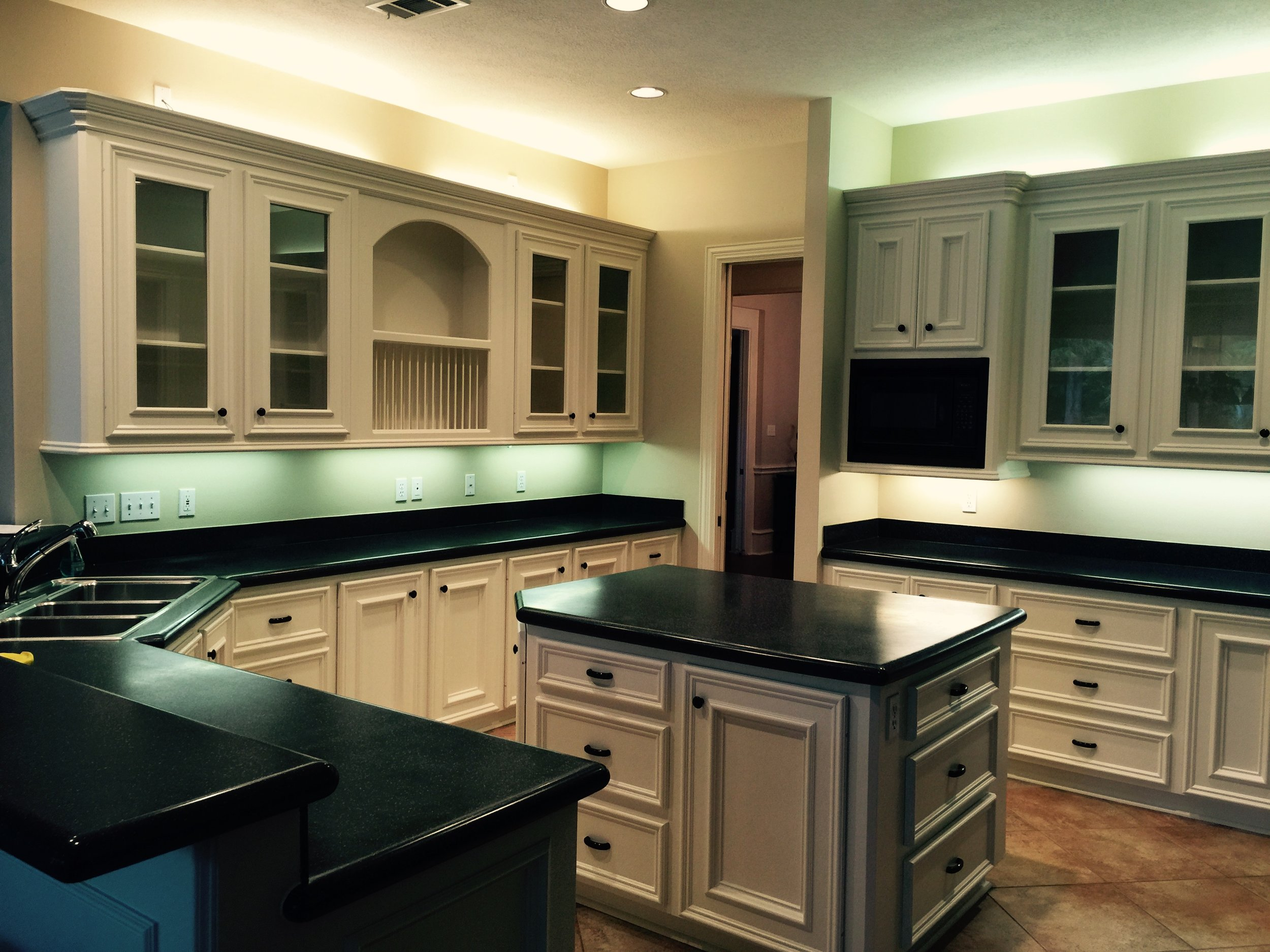 Here's an example of how the color of dated accent/task lighting can distort the color in a kitchen.... from one of my projects,  pre- construction.