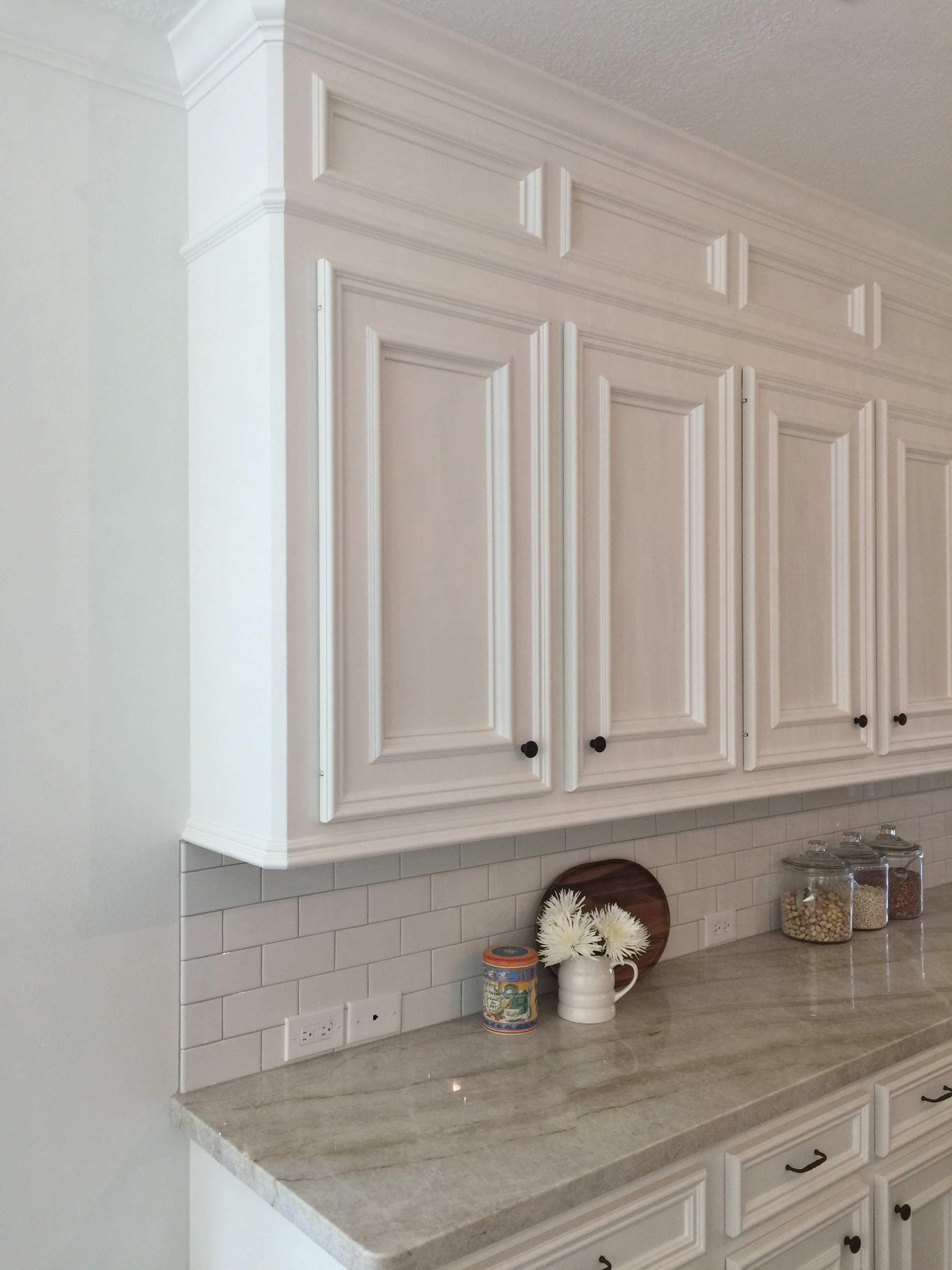 After - Modified cabinetry with new knife hinges replacing exposed hinges