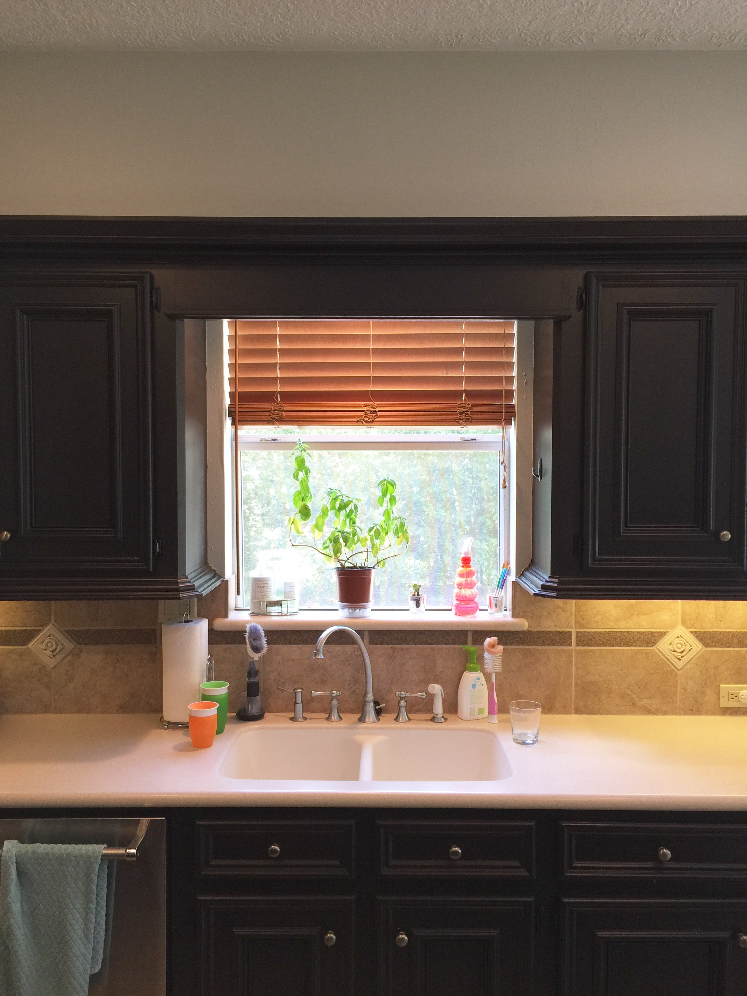 Before image- Kitchen remodel with existing cabinetry and furr down above.