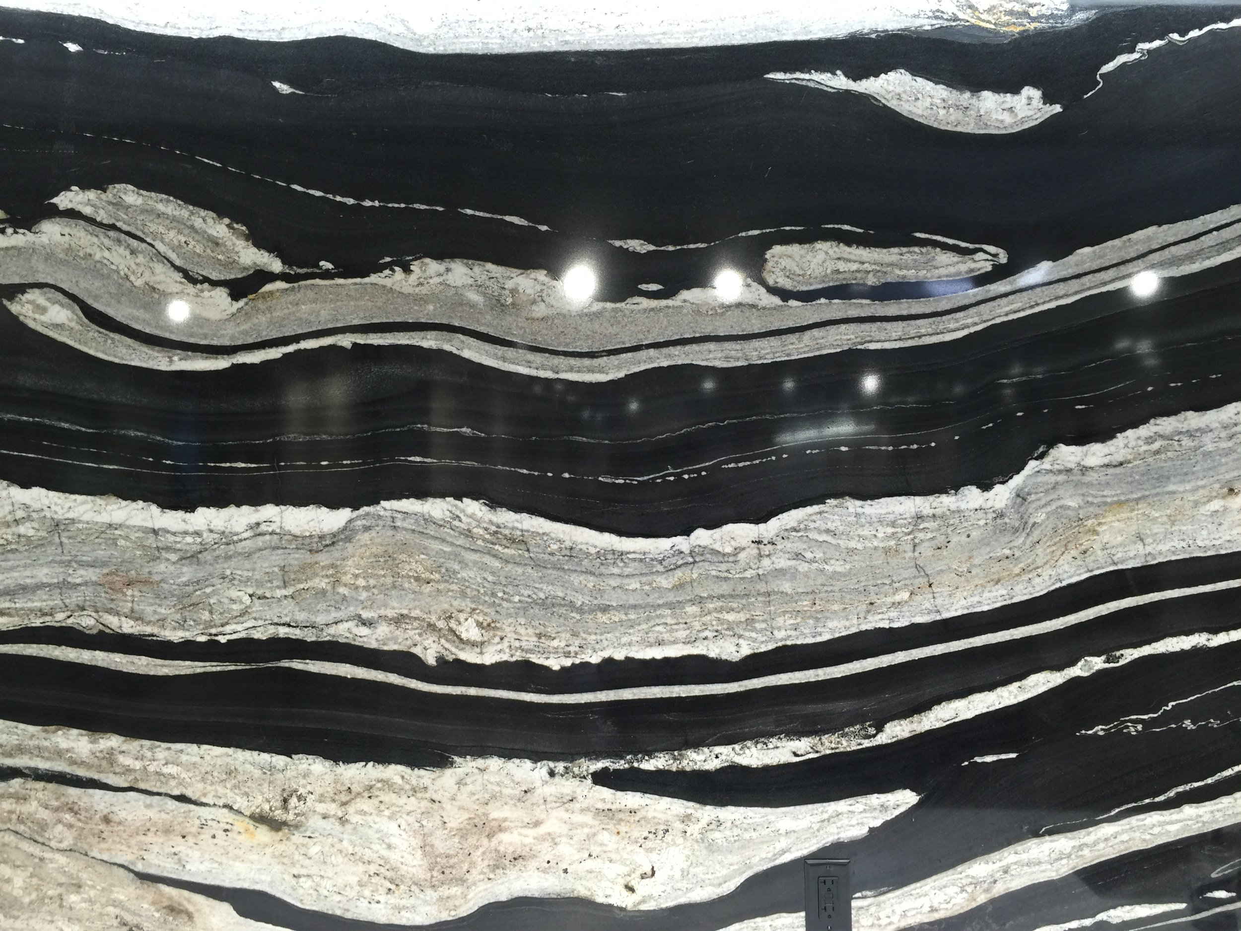 Daltile has some amazing slabs that can create art walls in your home.