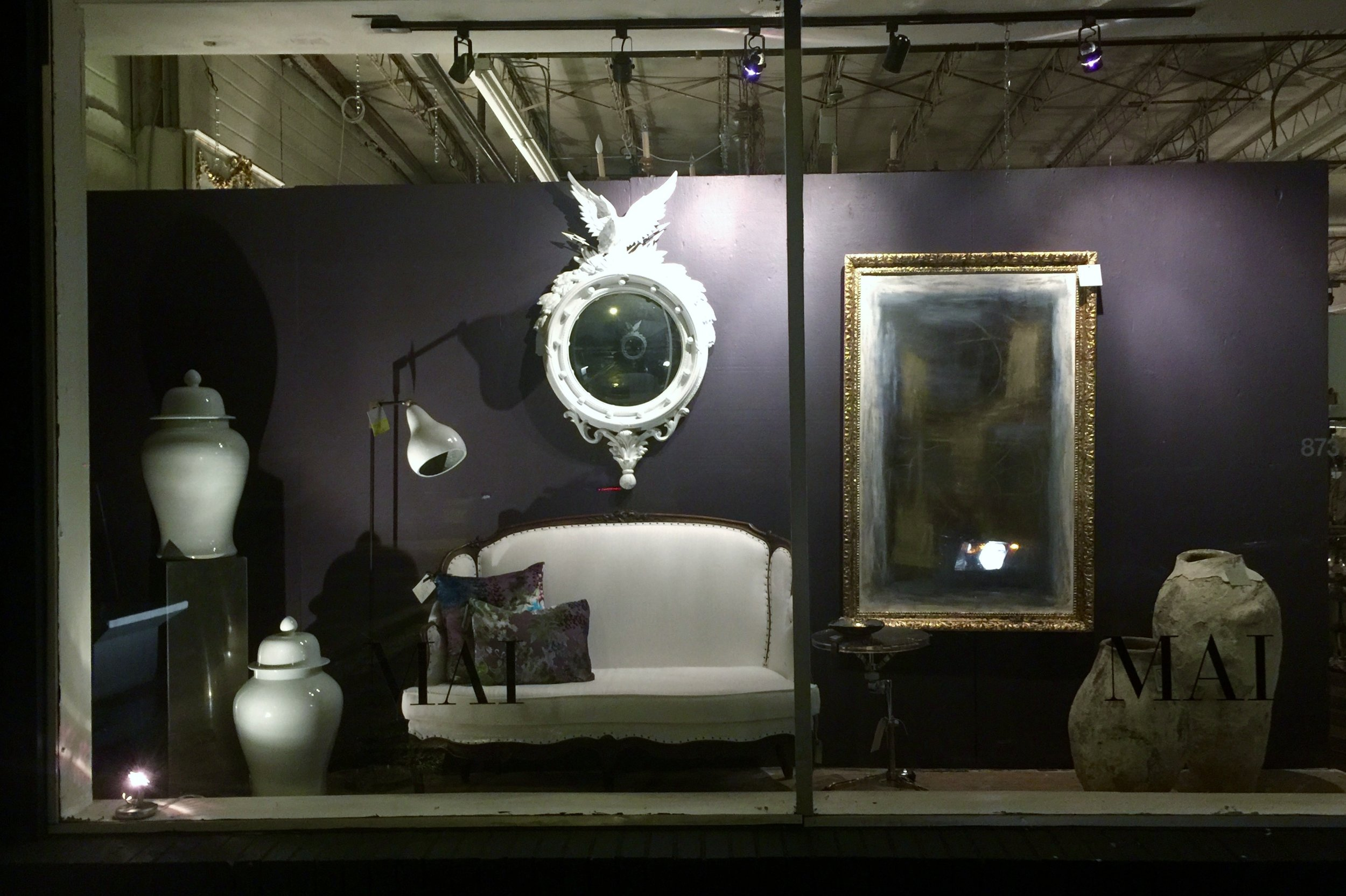 Night view of home furnishings decor window display - MAI, Houston, windows designed by Carla Aston