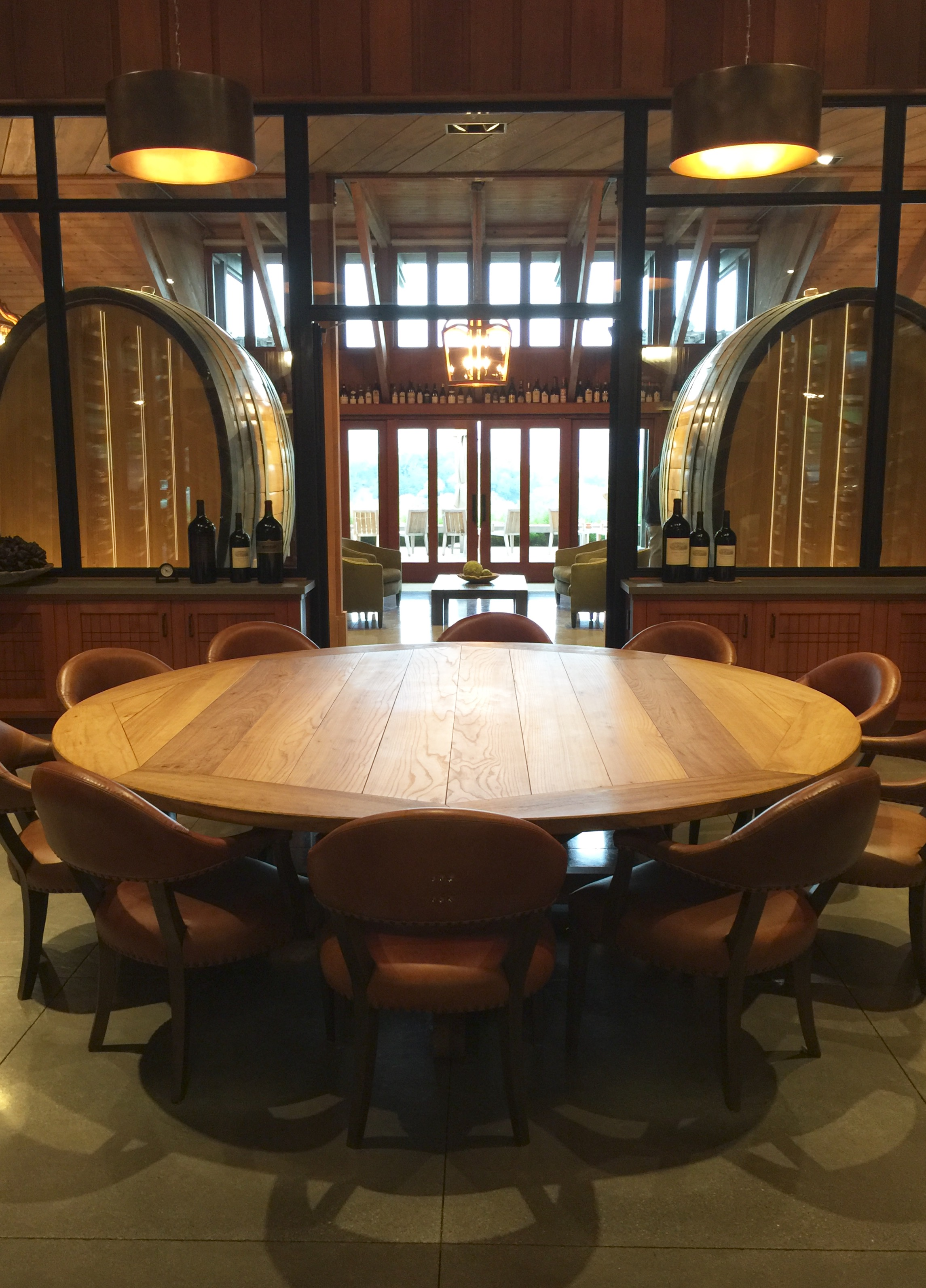 A custom made table centers in the Library, developed to tell the winery's history and display historic bottles.