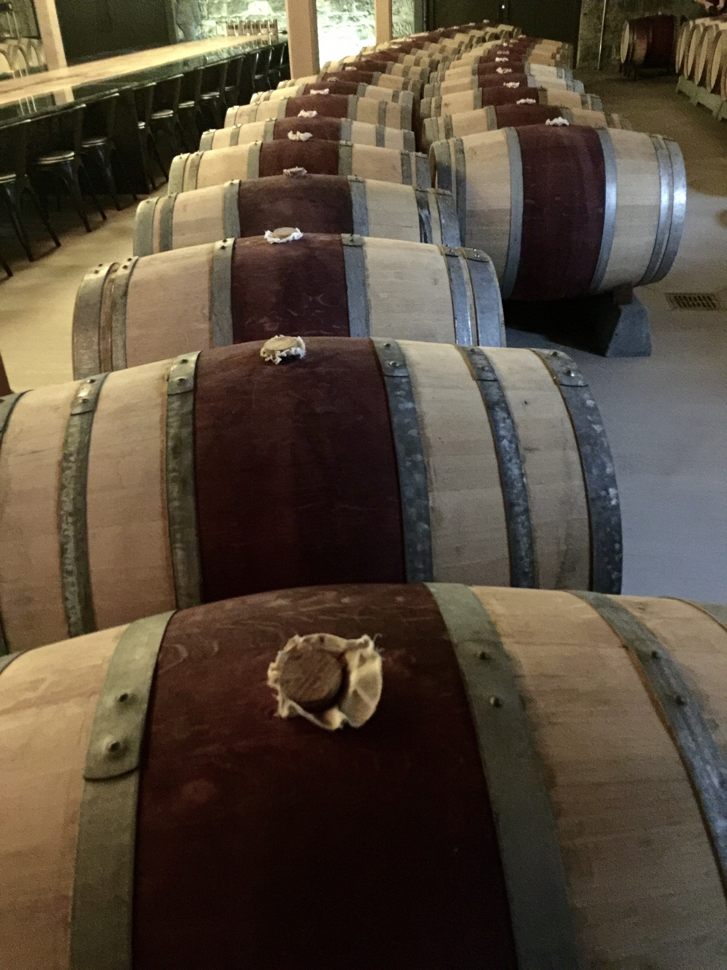 Wine barrels in the old stone building. We tasted directly from the barrel here.