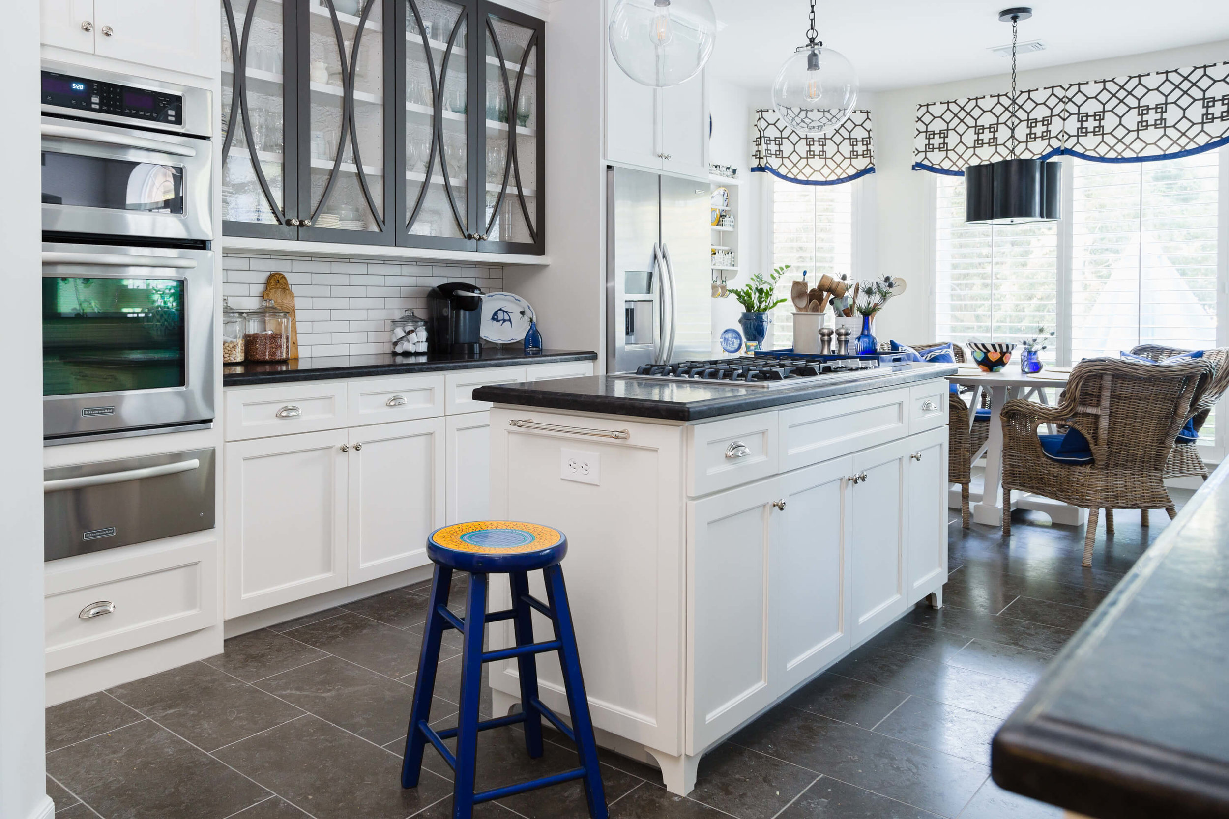 White kitchen with X front cabinet doors, Designer: Carla Aston