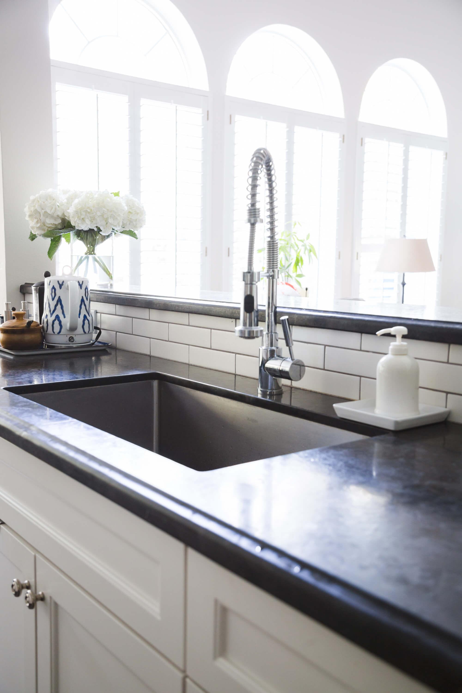 White kitchen with subway tile backsplash and pro style kitchen faucet, Designer: Carla Aston