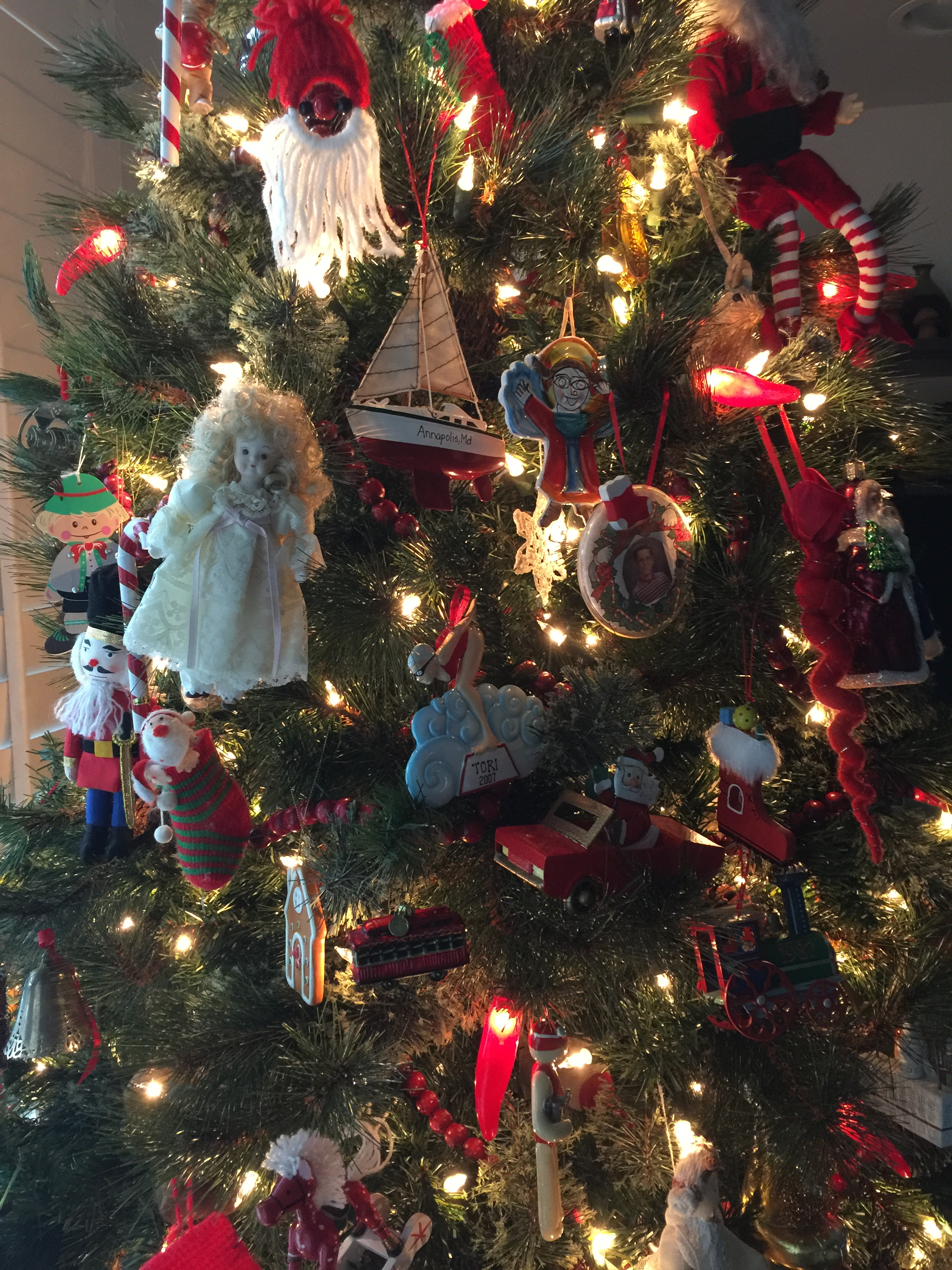 My Christmas tree decorated with all kinds of ornaments collected over the years.