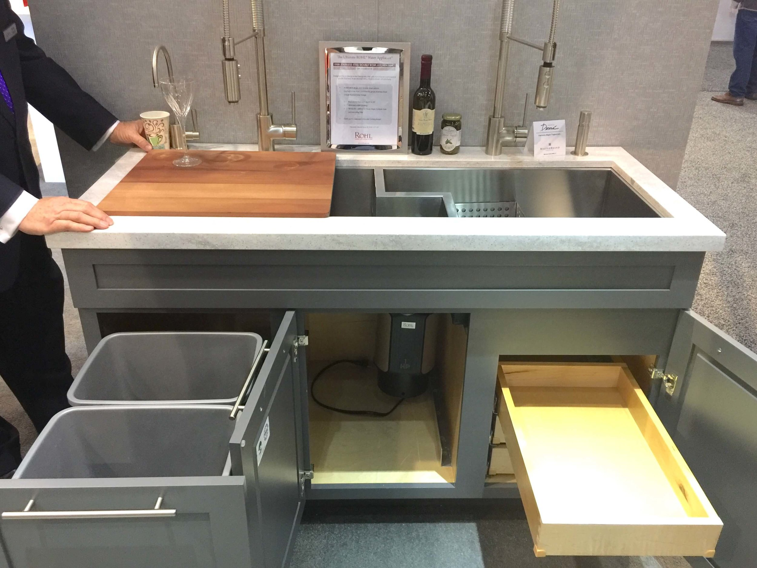 "Rohl extra wide prototype sink with drains centered in 18"" wide center cabinet and maximum storage below in adjacent cabinets."