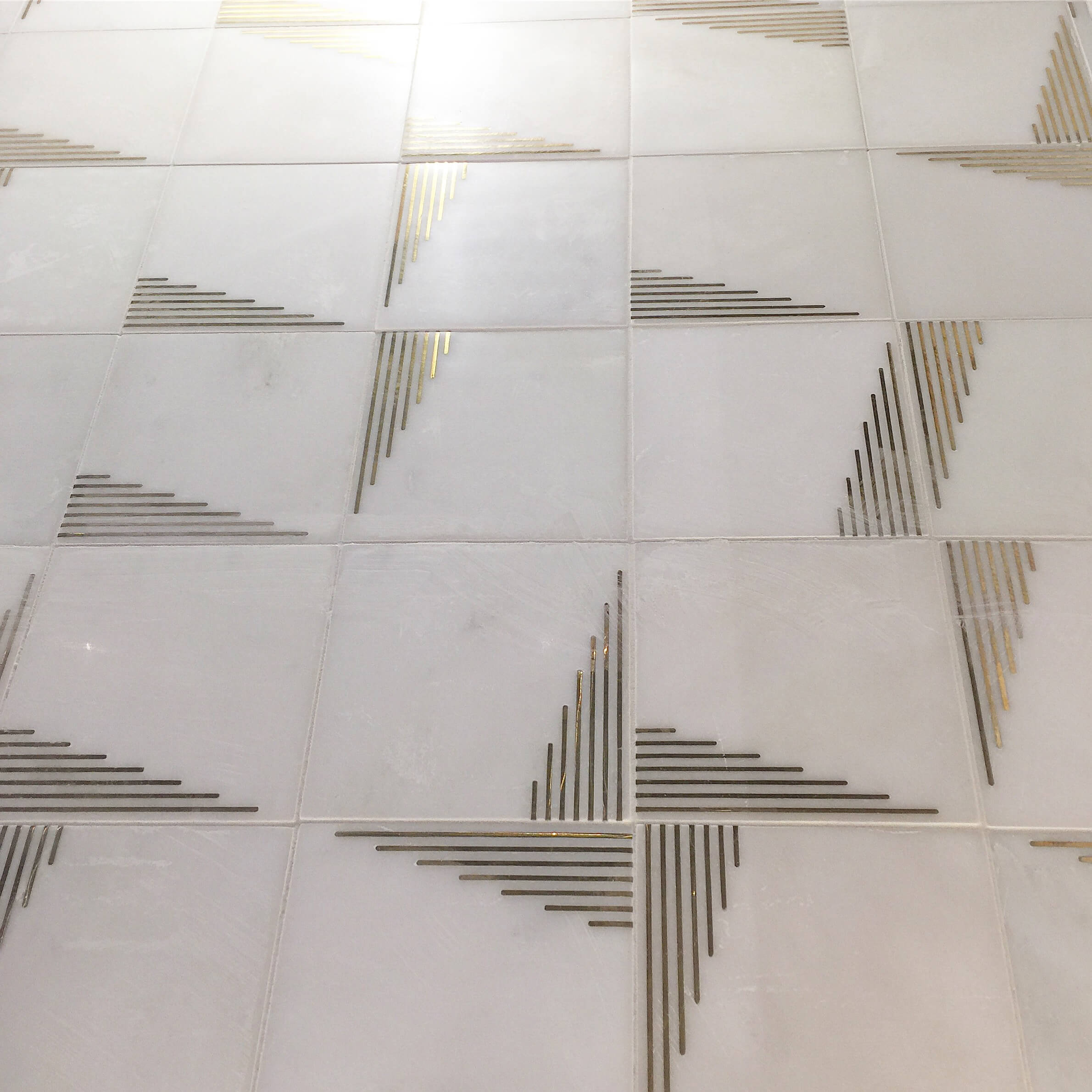 These beautiful marble tiles from Ann Sacks are sold with or without the brass inlay and patterns can be developed turning the tiles in different directions.