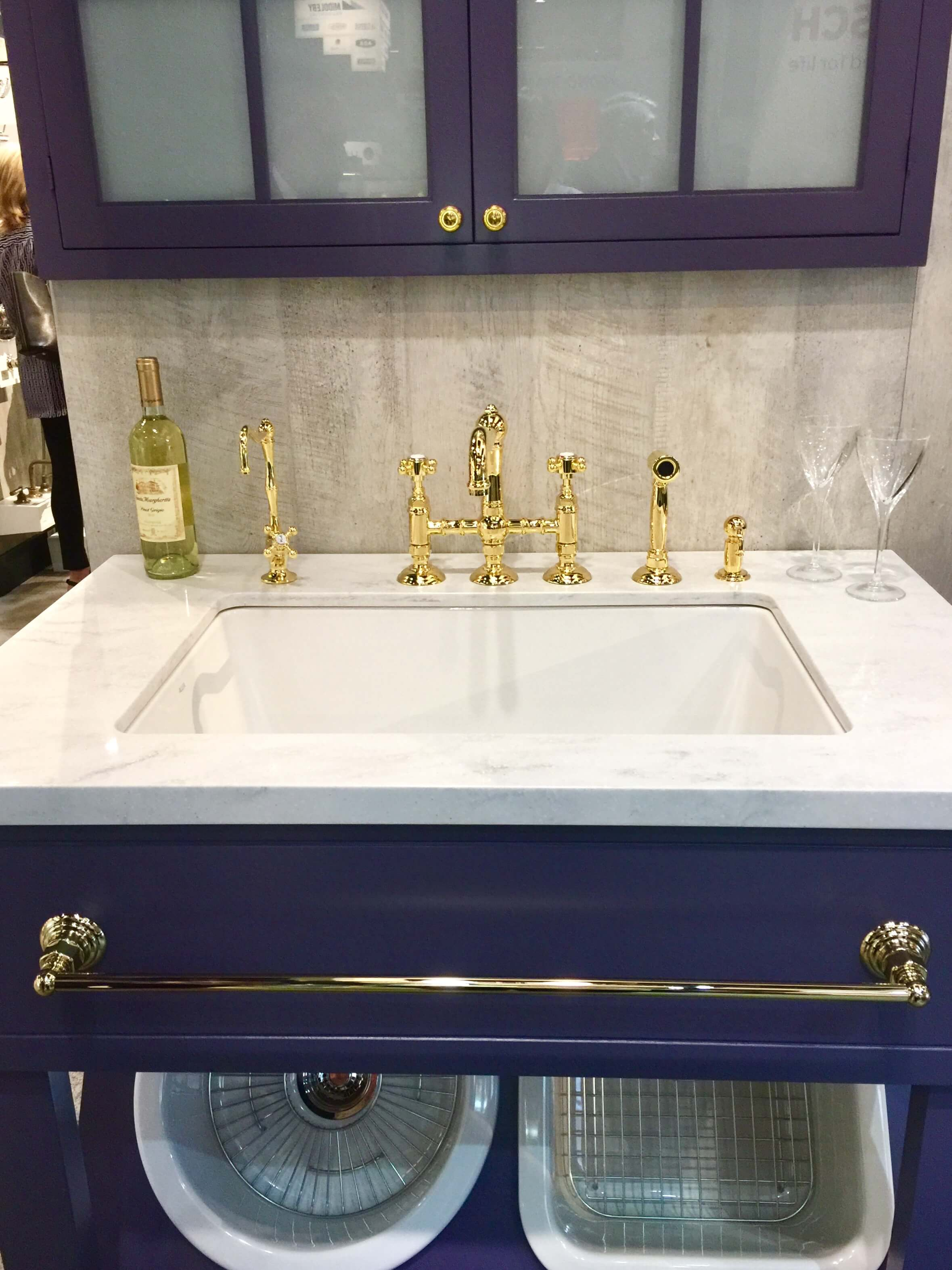 Blue cabinets look gorgeous with white counters and brass faucets and fittings from Rohl