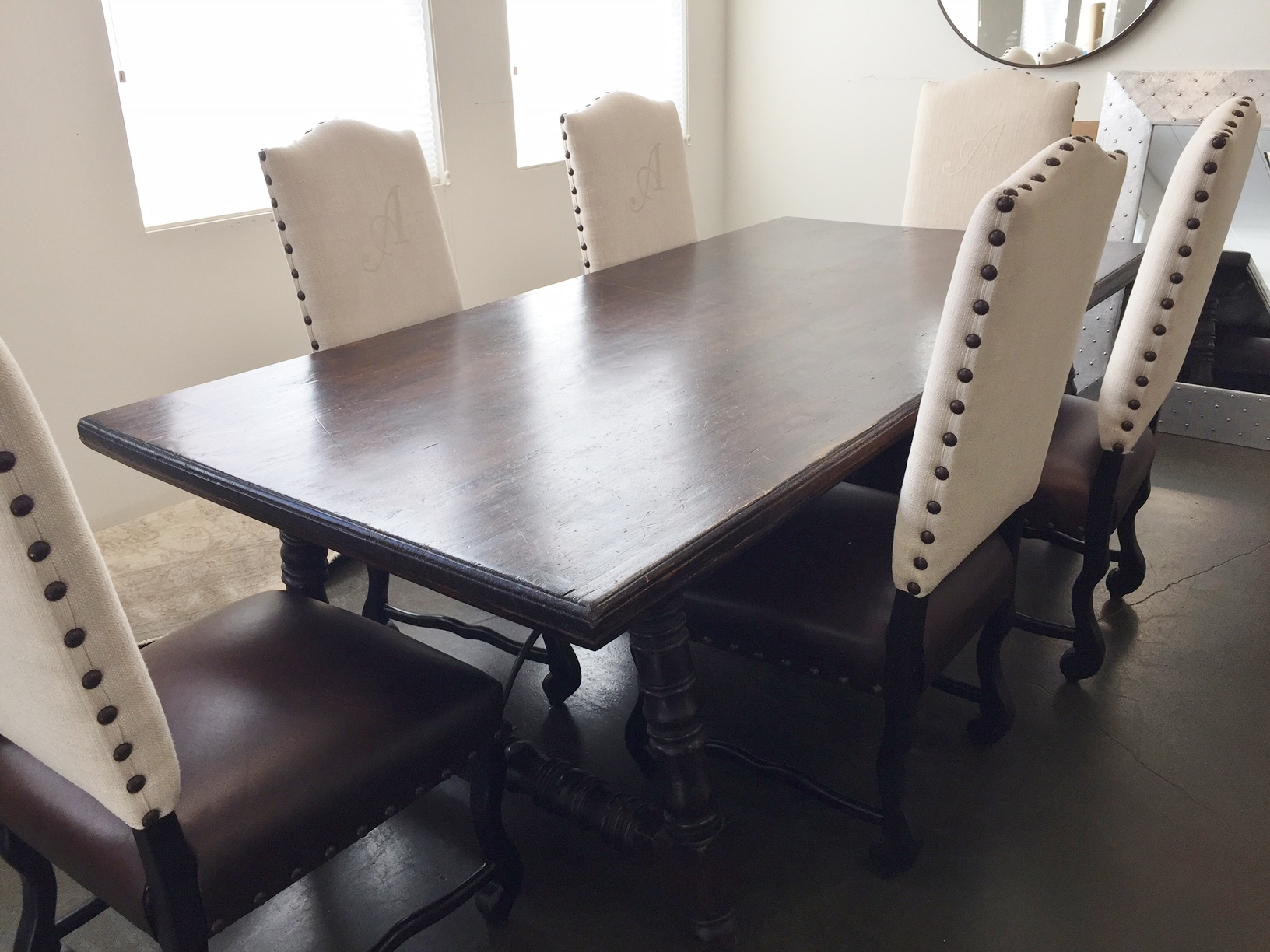 """FOR SALE - 8' x 46"""" Dark wood dining table and 6 Tuscan style chairs with leather seats and linen backs"""