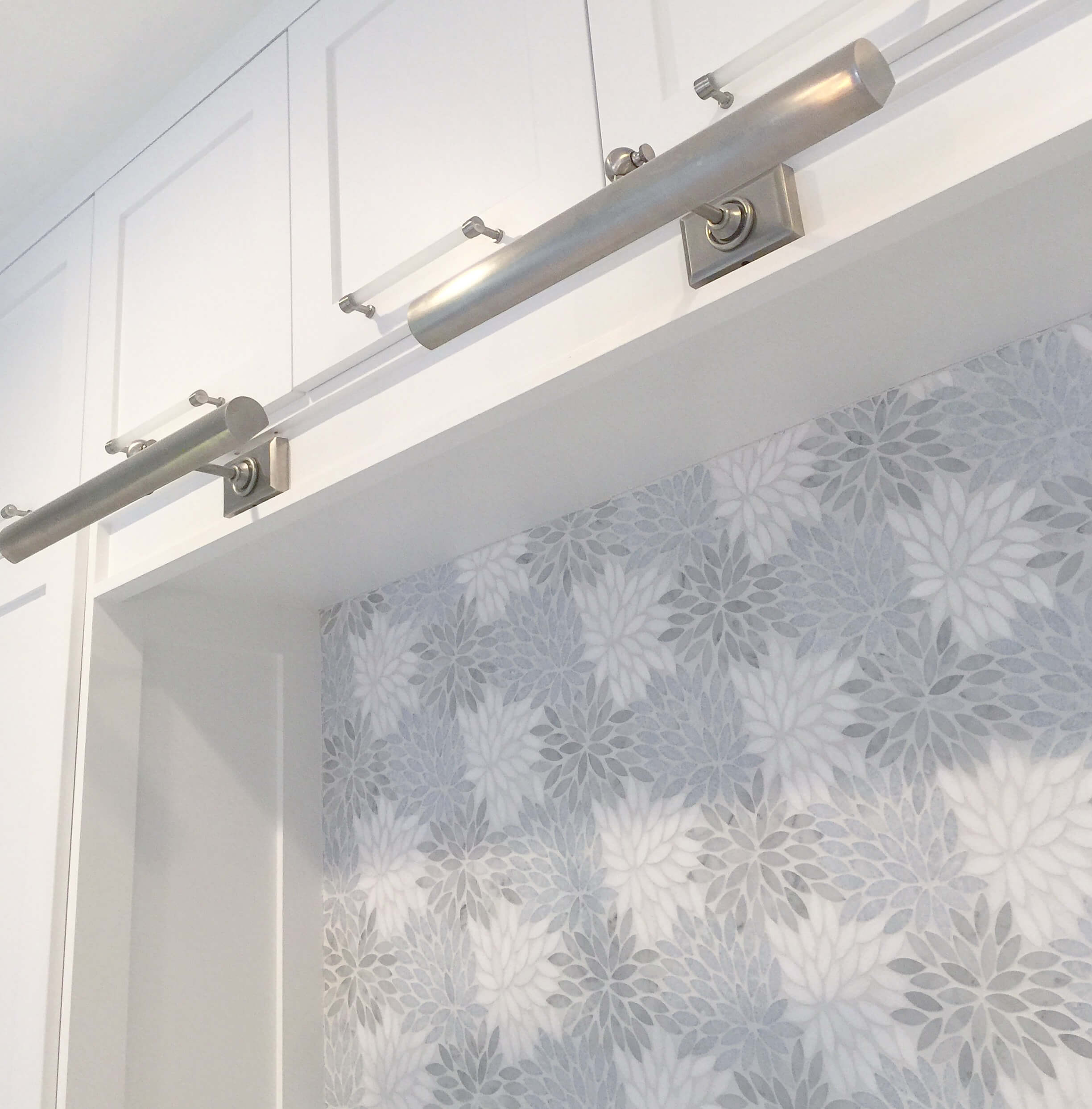 Satin nickel picture lights with marble mosaic backsplash from Artistic Tile