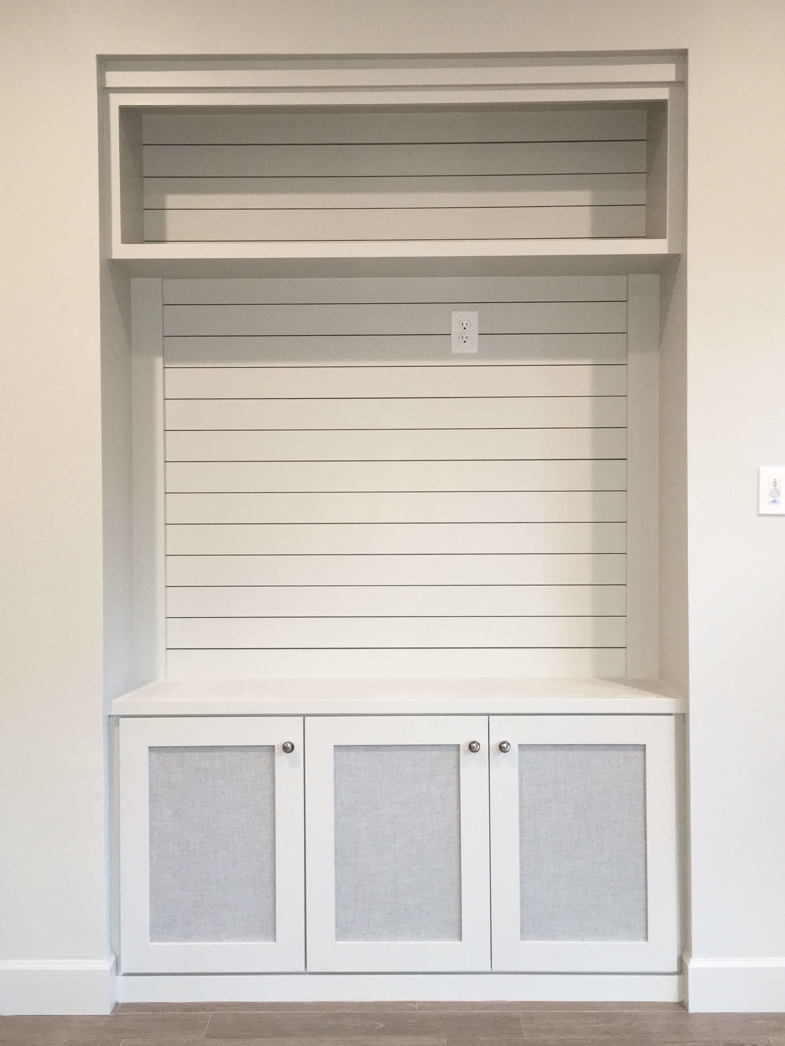 TV / Entertainment center built-in with shiplap back and speaker fabric panels