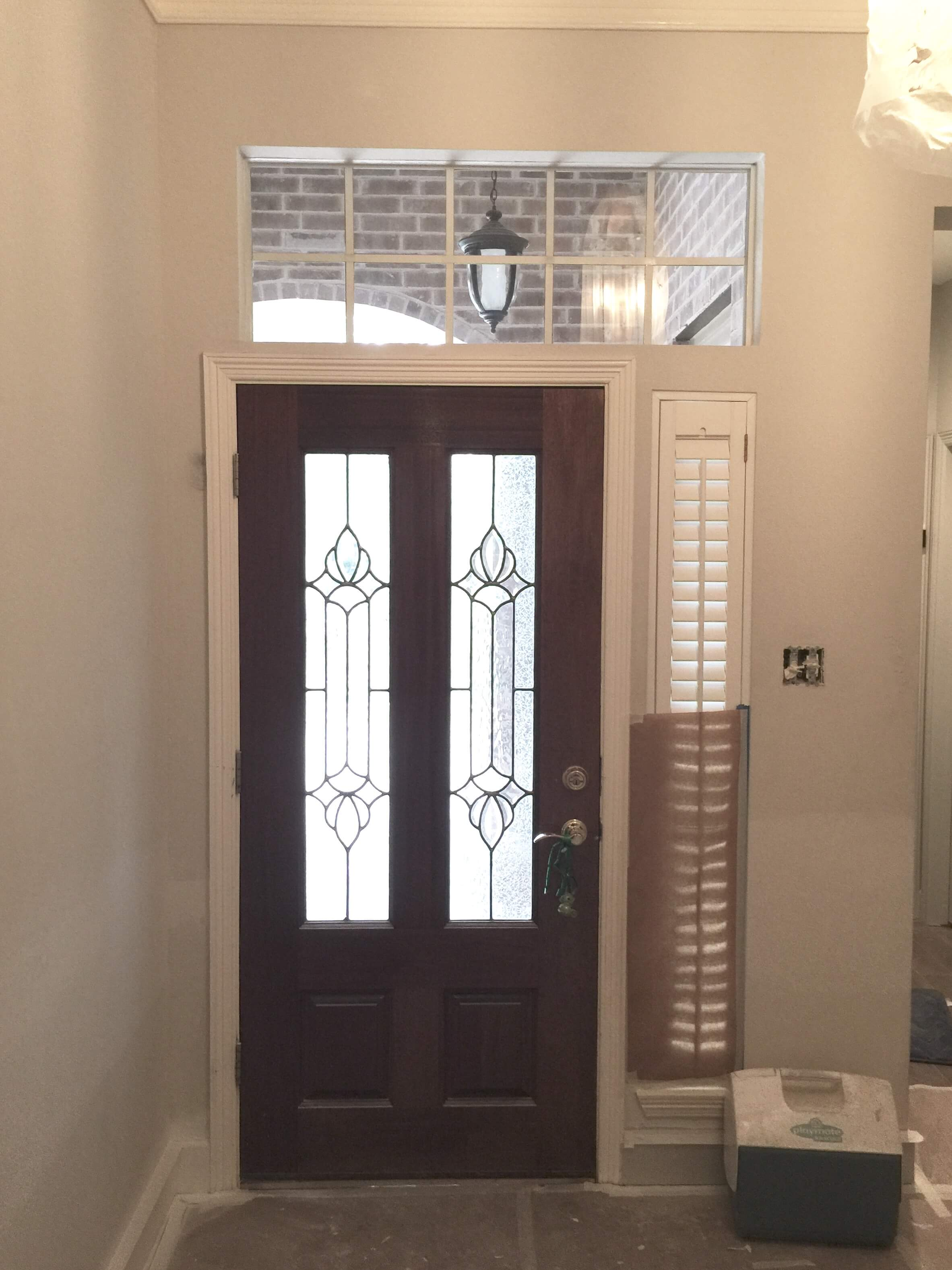 Before - entry door with minimal mouldings around openings. #mouldings #interiordesigntips