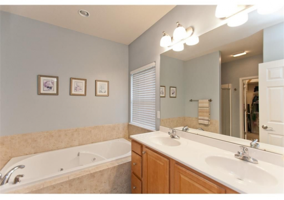 A cool gray next to a travertine appears blue like it does in this bathroom.