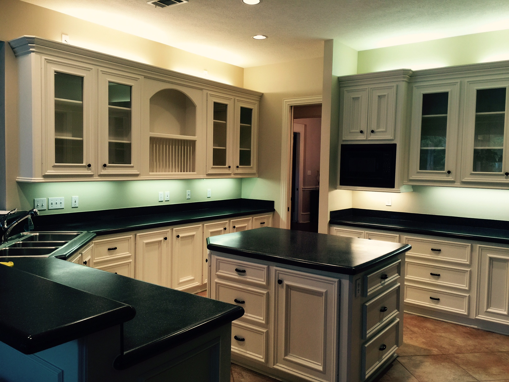 Here's a good example of how different types of lighting can turn a white kitchen all kinds of different colors. (This was a pre-project photo.)