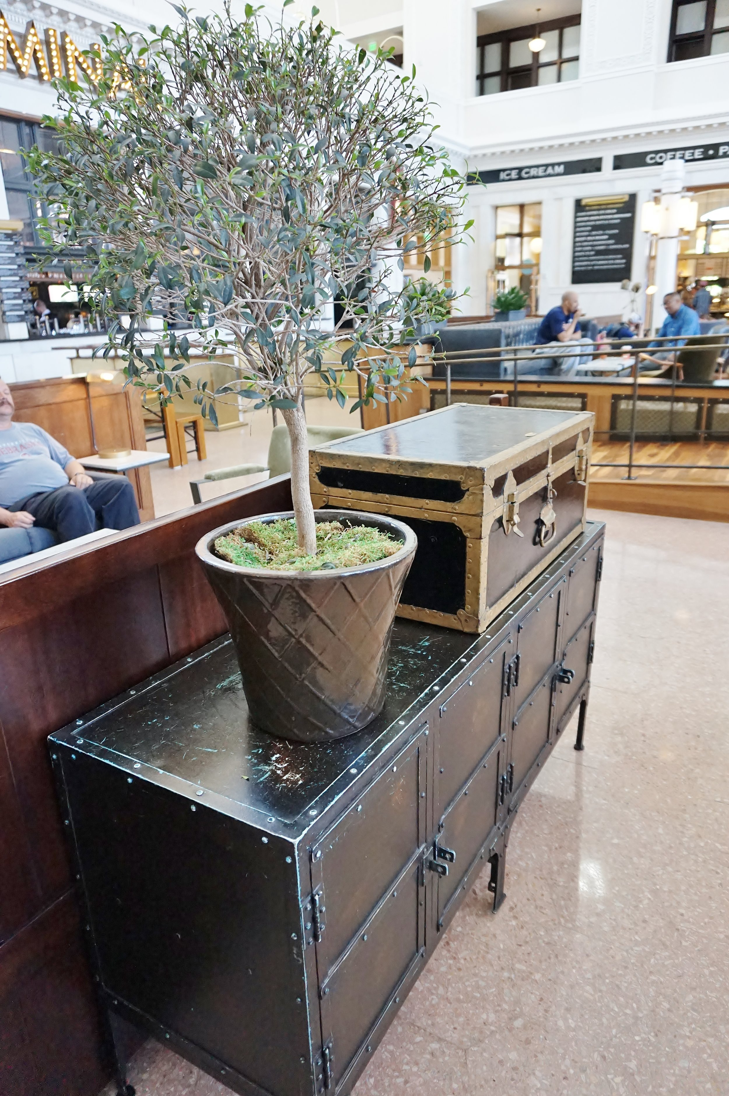 Trunks and industrial style furnishings are used as accent pieces in the lobby of The Crawford Hotel | Union Station | Denver