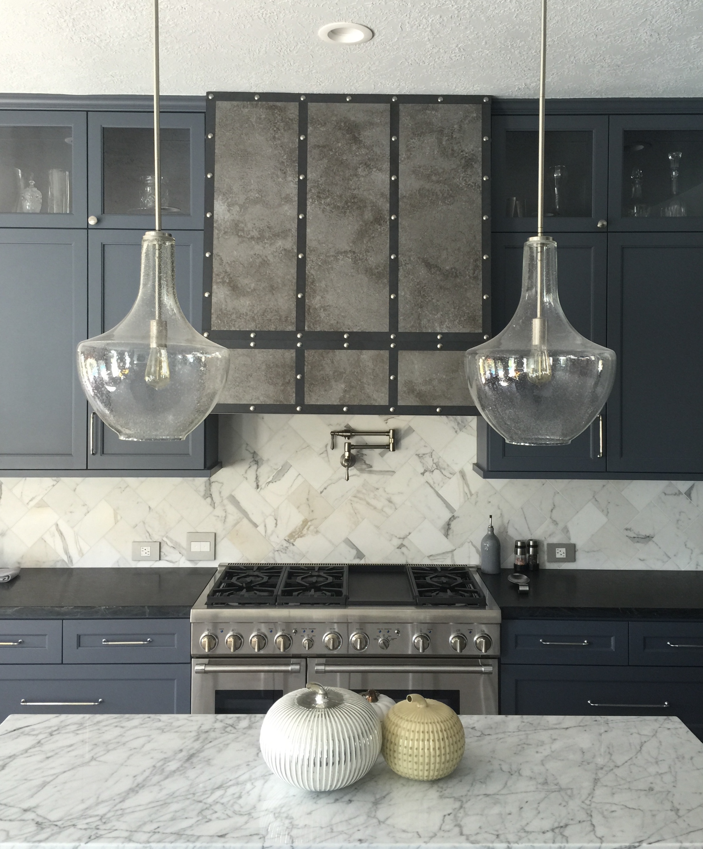 White marble on kitchen island and soapstone counter at perimeter cabinets - Carla Aston Designer