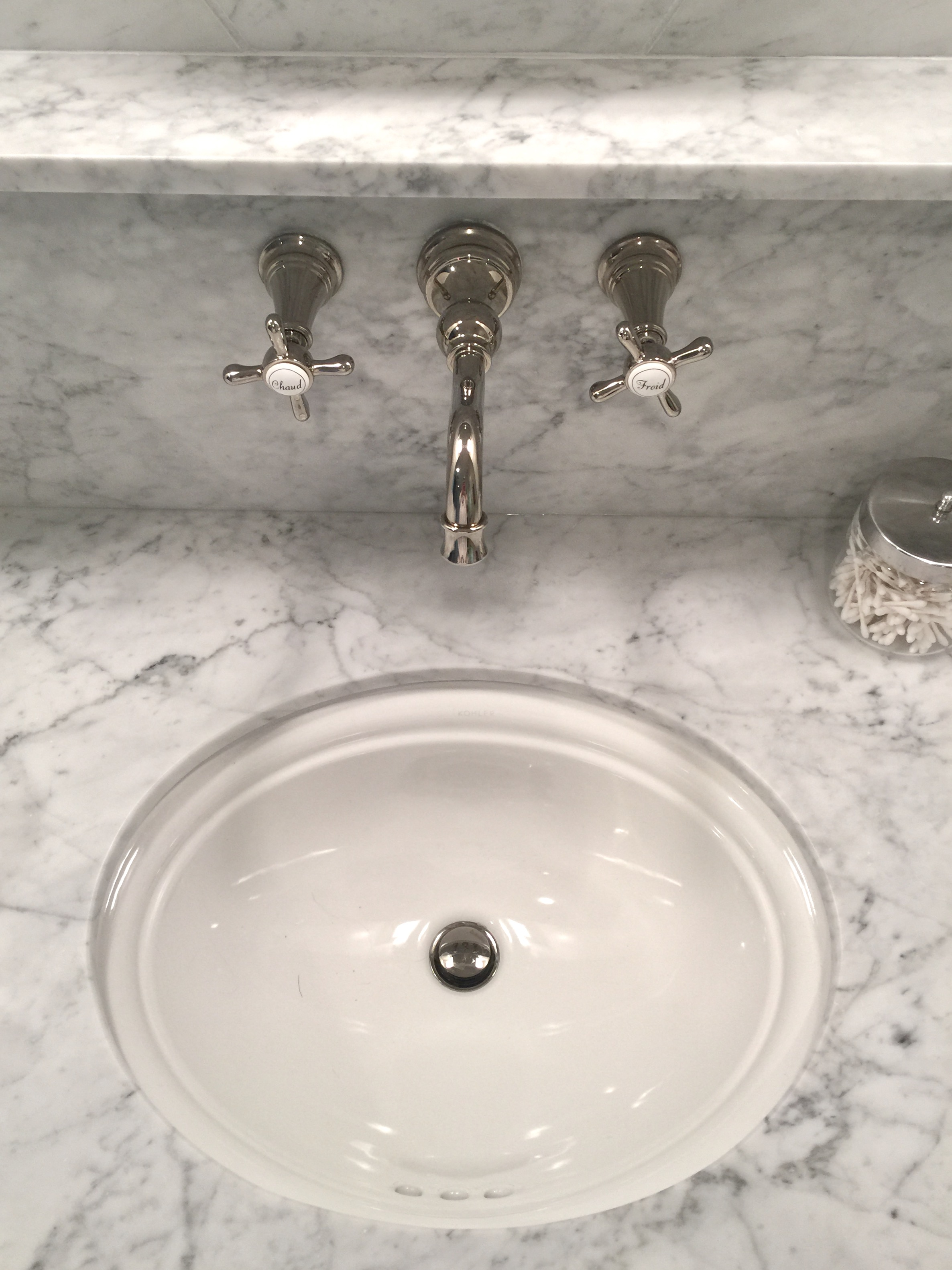 Cararra marble countertop and splash with wall mount faucet - Designer: Carla Aston