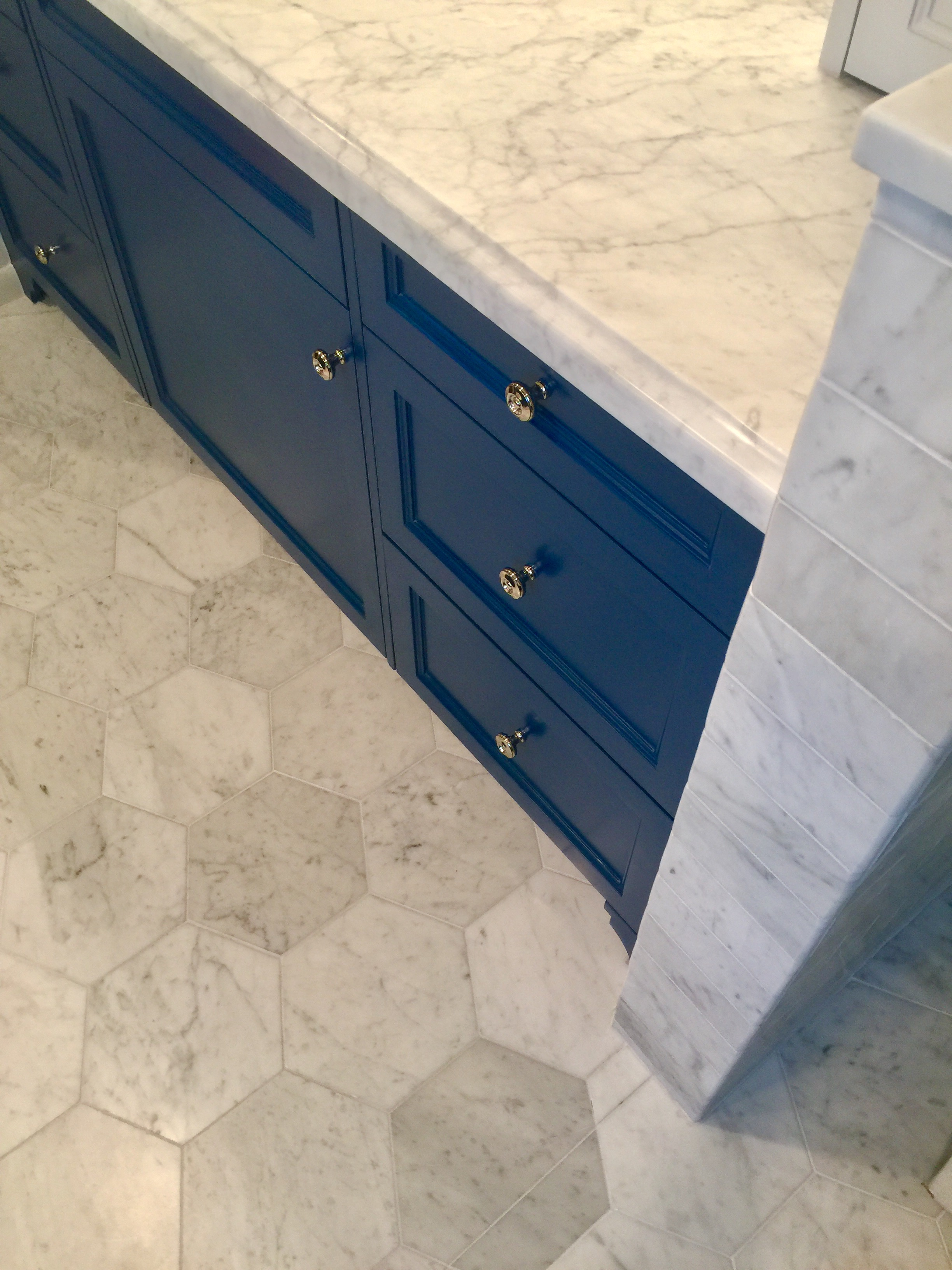 Navy cabinetry with Cararra marble hex tile floor - Designer: Carla Aston