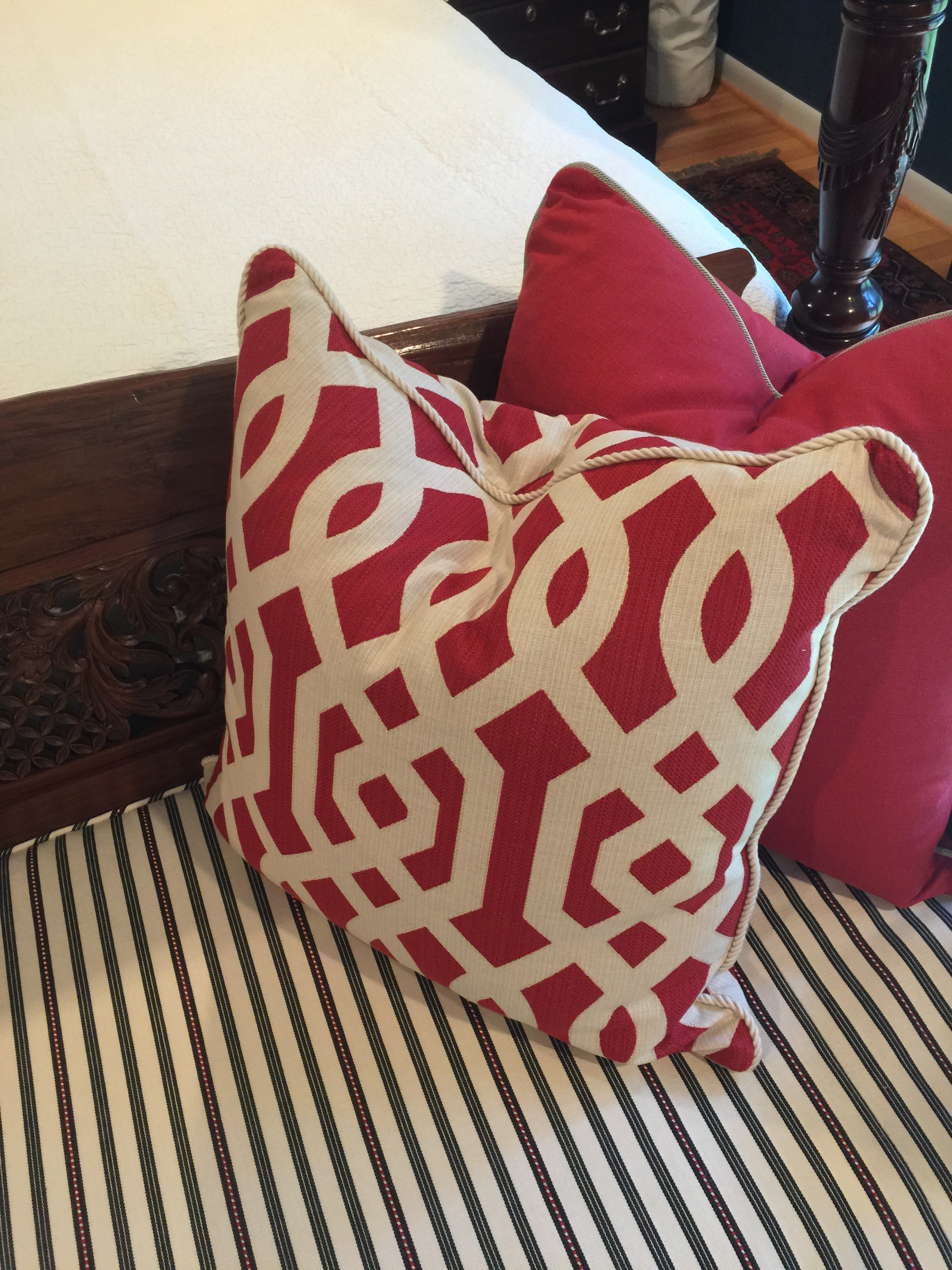 Bench cushion and pillows in red fabrics - Designer: Carla Aston