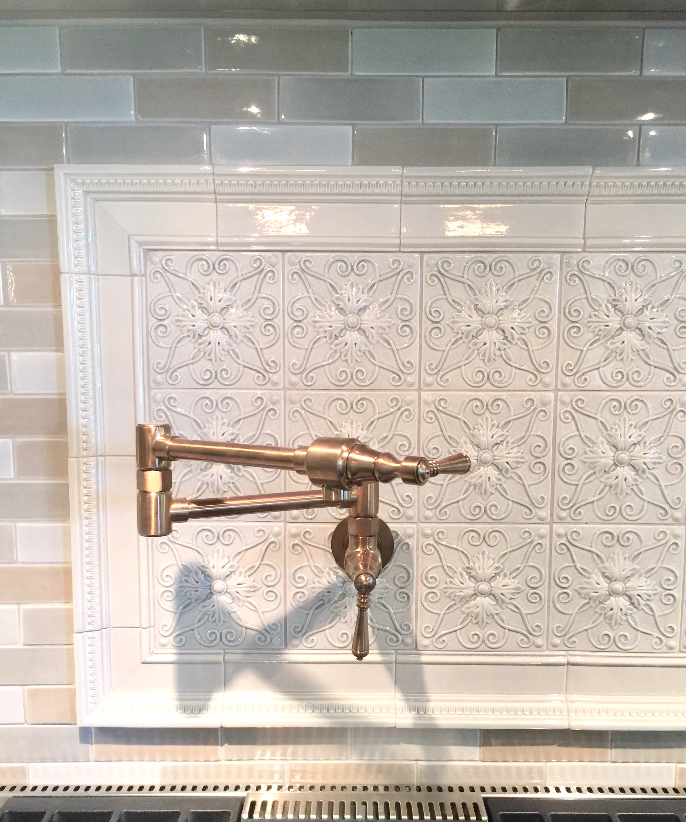 Intricate tile backsplash with potfiller and tile from Walker Zanger - Designer Donna Jarnigan